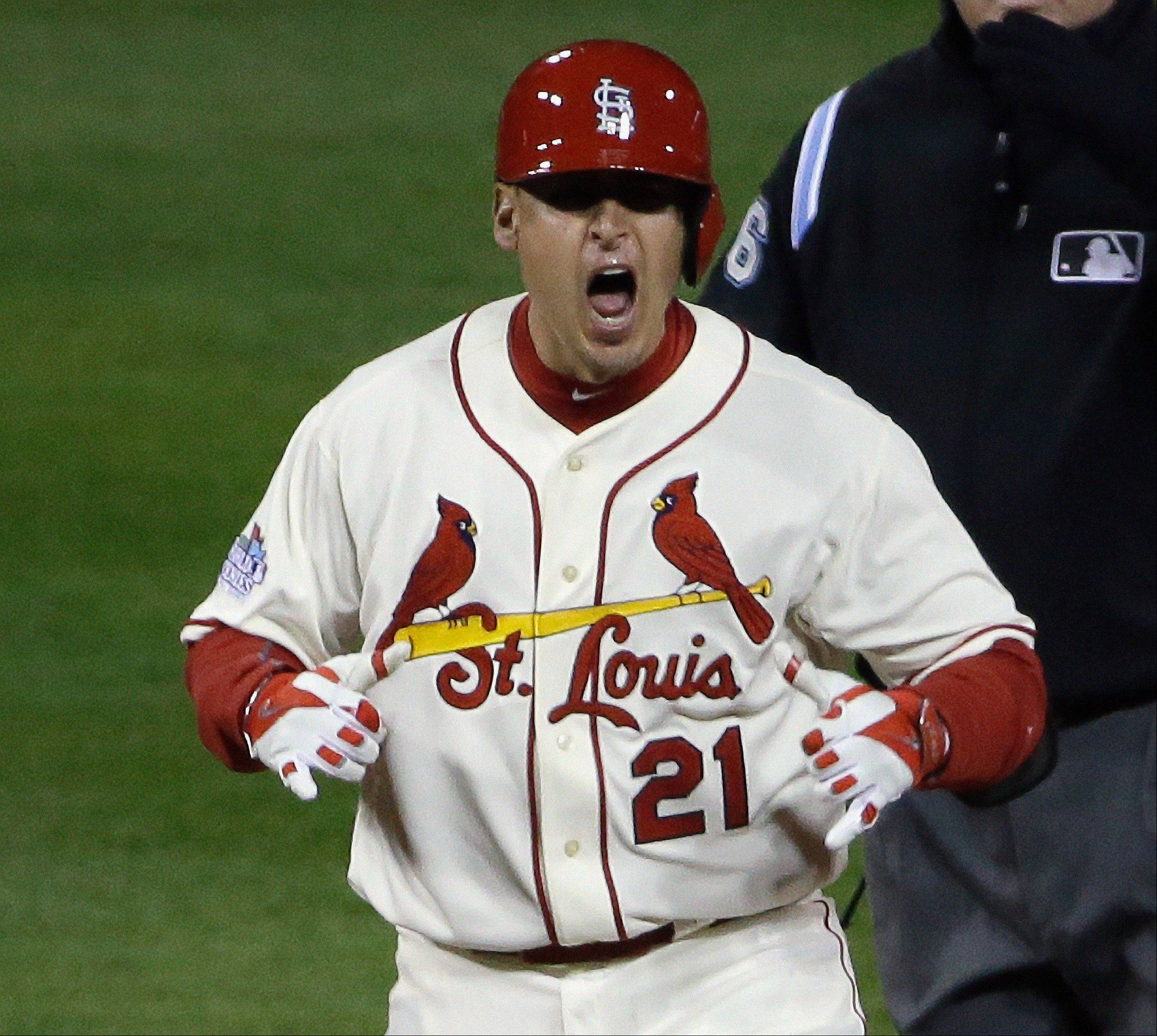 St. Louis Cardinals' Allen Craig reacts after hitting a double during the ninth inning of Game 3.