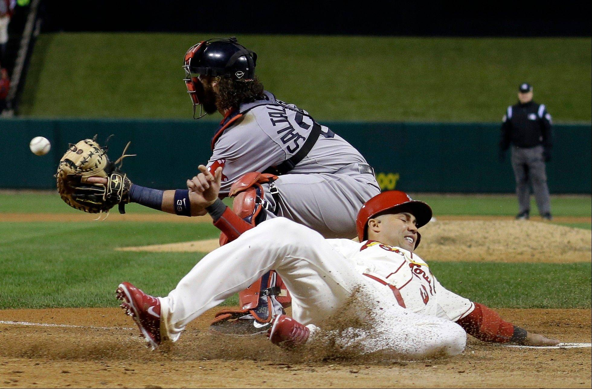 St. Louis Cardinals' Carlos Beltran slides safely past Boston Red Sox catcher Jarrod Saltalamacchia during the seventh inning.