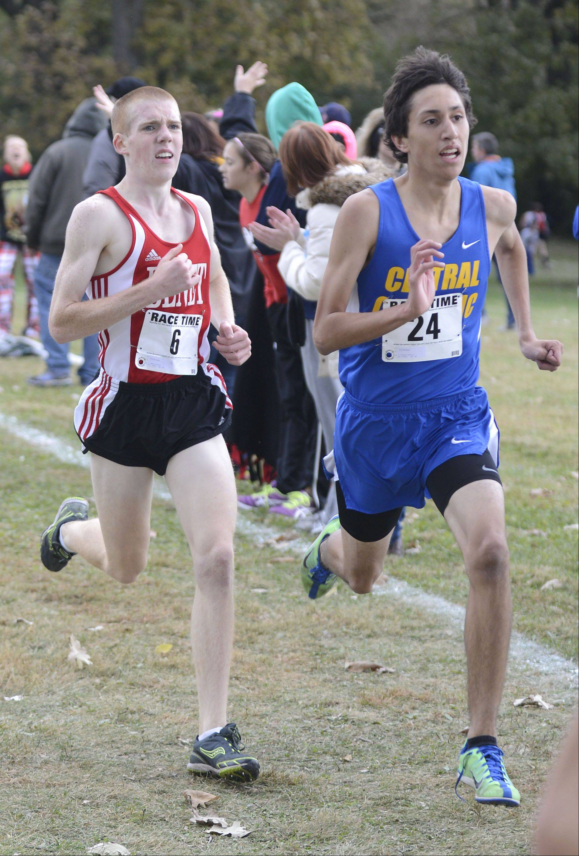 Benet Academy's Brady McLaughlin and Aurora Central Catholic's Javier Montelongo battle to the finish line in the Class 2A cross country regional on Saturday, October 26. Montelongo took 11th place and McLaughlin took 14th.