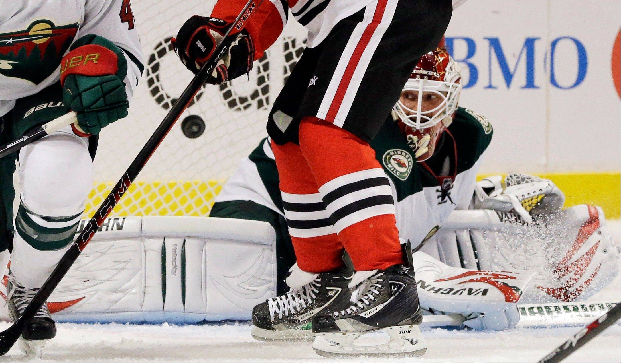 Minnesota Wild goalie Niklas Backstrom (32) can't save a goal by Chicago Blackhawks' Bryan Bickell (29) during the second period.