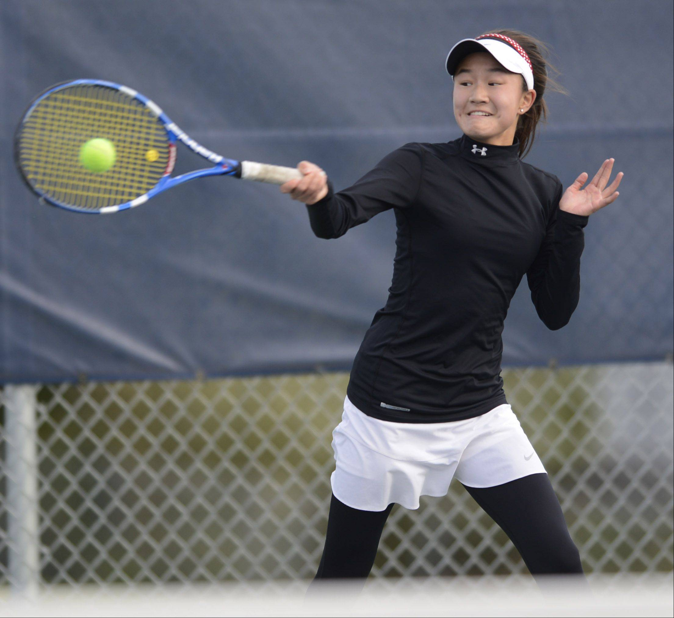 Naperville Central's Tiffany Chen returns the ball during the girls state tennis semifinals at Buffalo Grove High School Saturday.