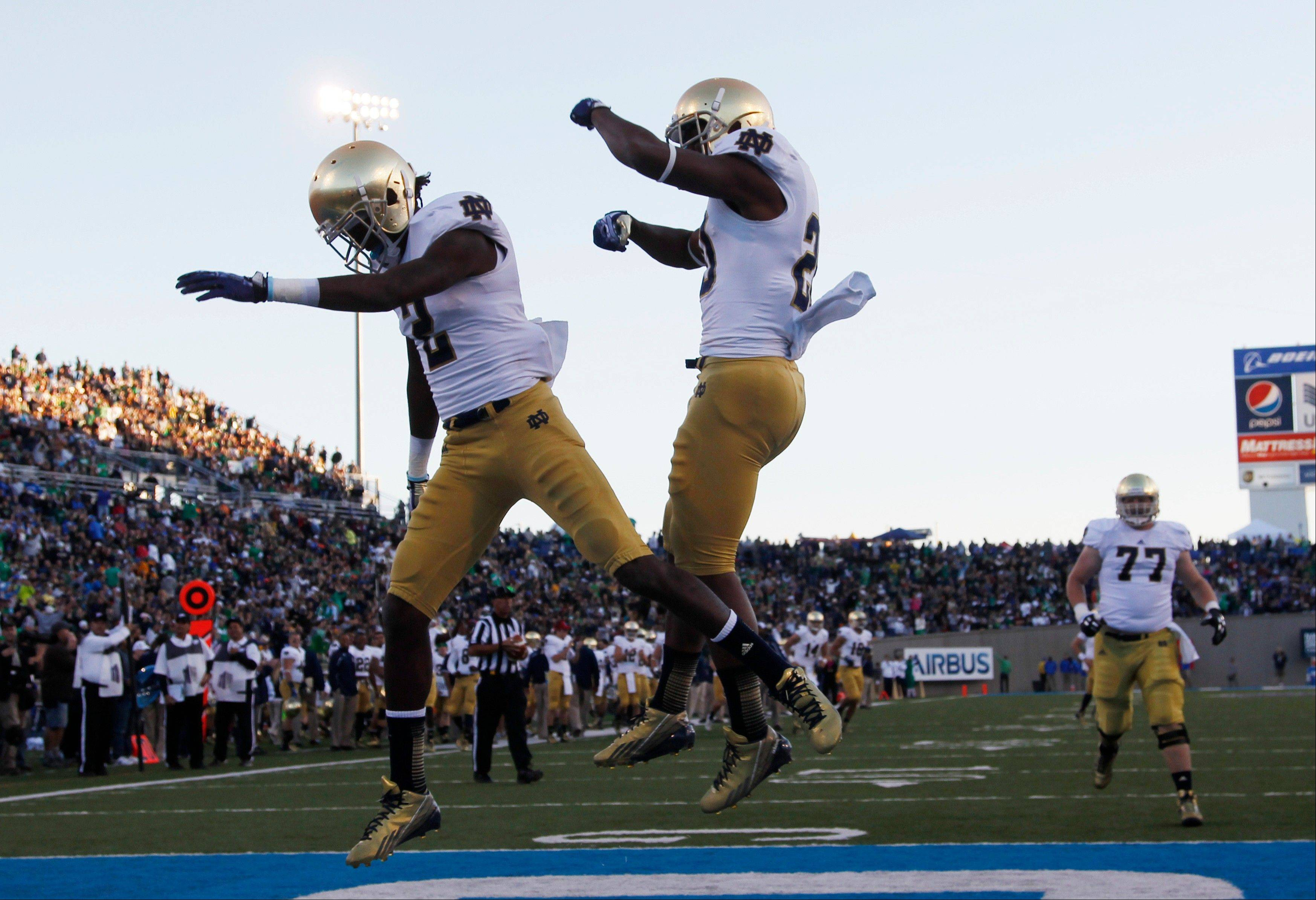 Notre Dame wide receiver Chris Brown, left, celebrates his touchdown catch with teammate C.J. Prosise against Air Force in the third quarter.