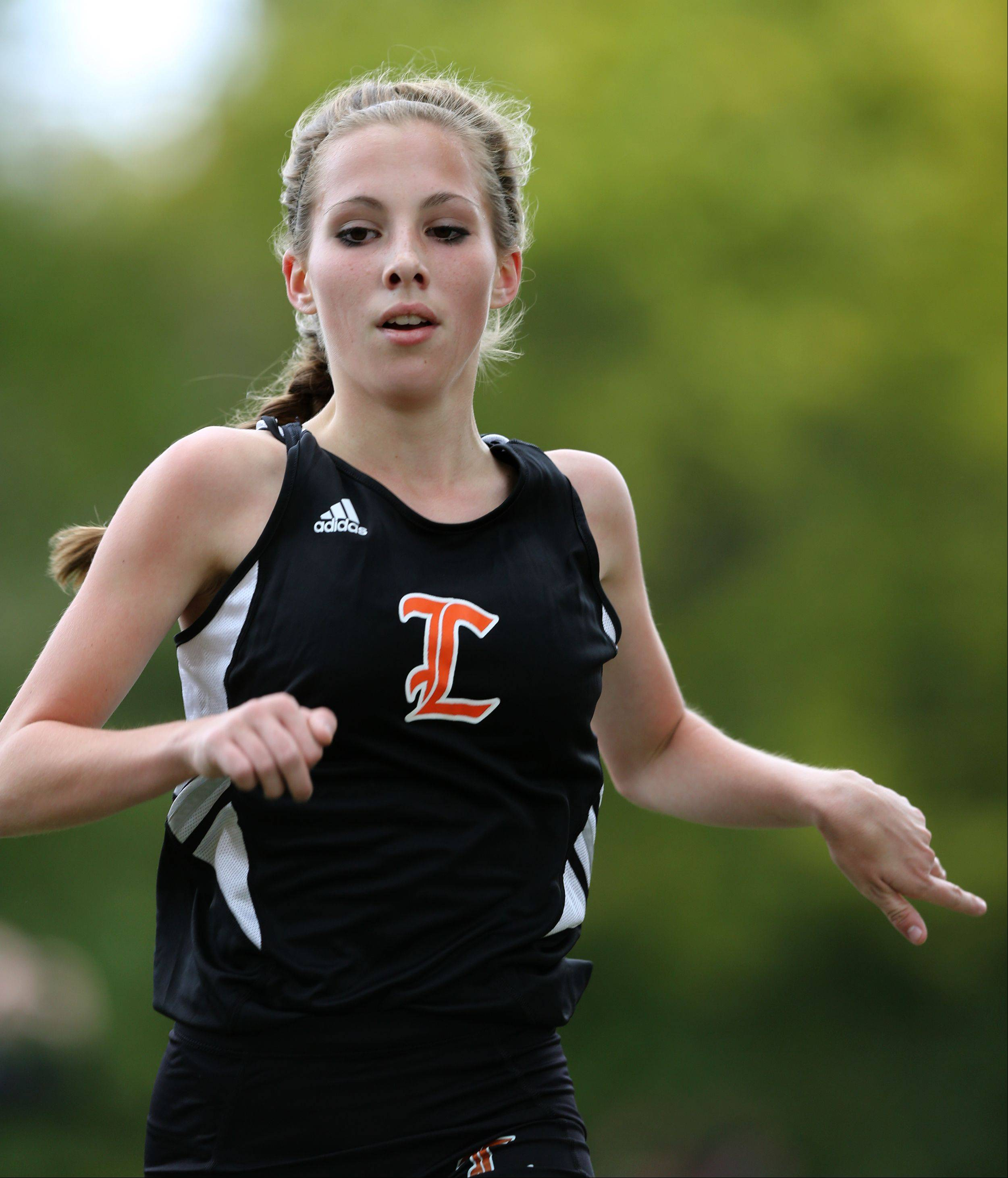 Libertyville's Emily Olson finishes the Class 3A Libertyville cross country regional at Adler Park.