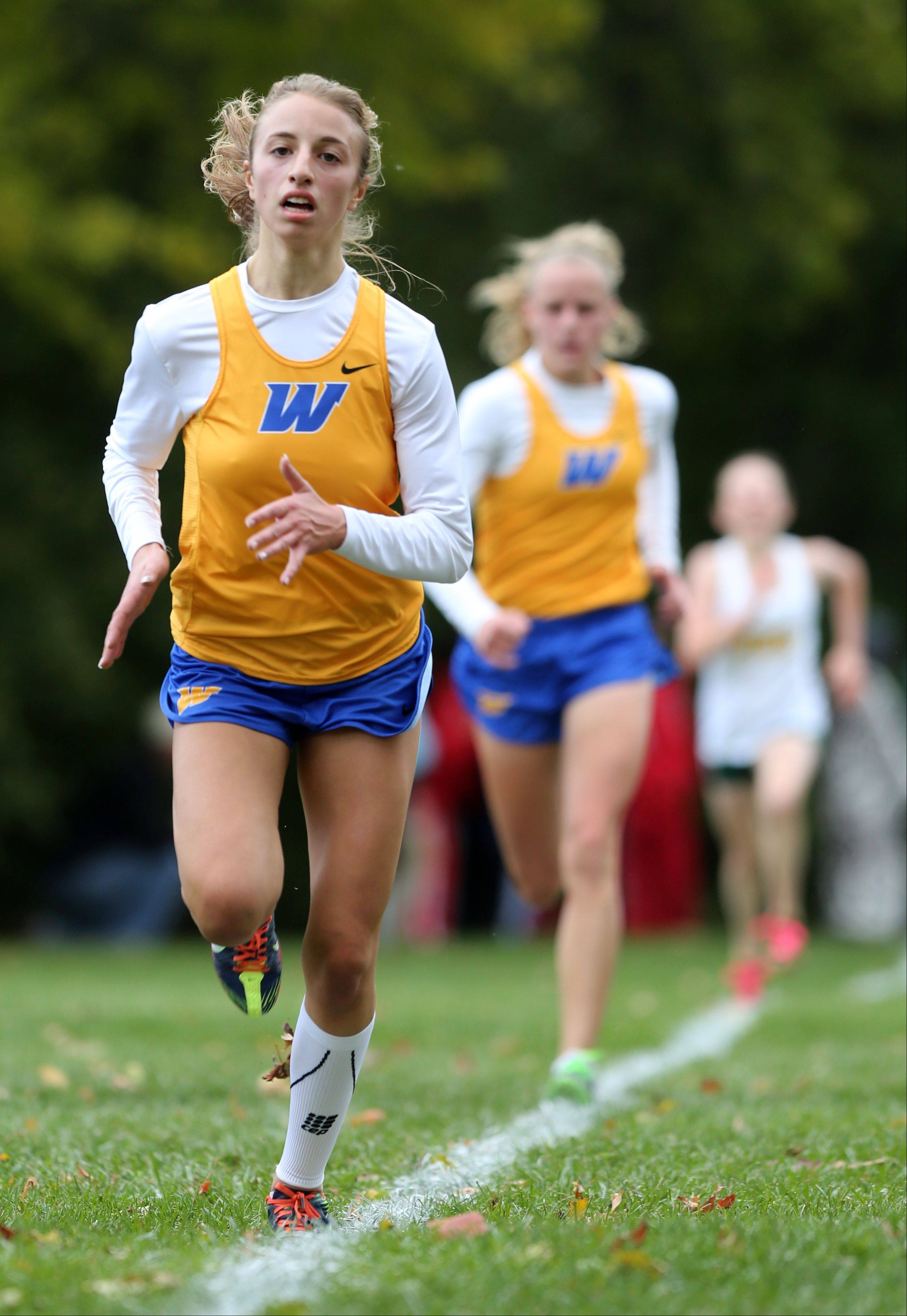 Warren's Becky Haight eyes the finish line during the Class 3A Libertyville cross country regional at Adler Park.