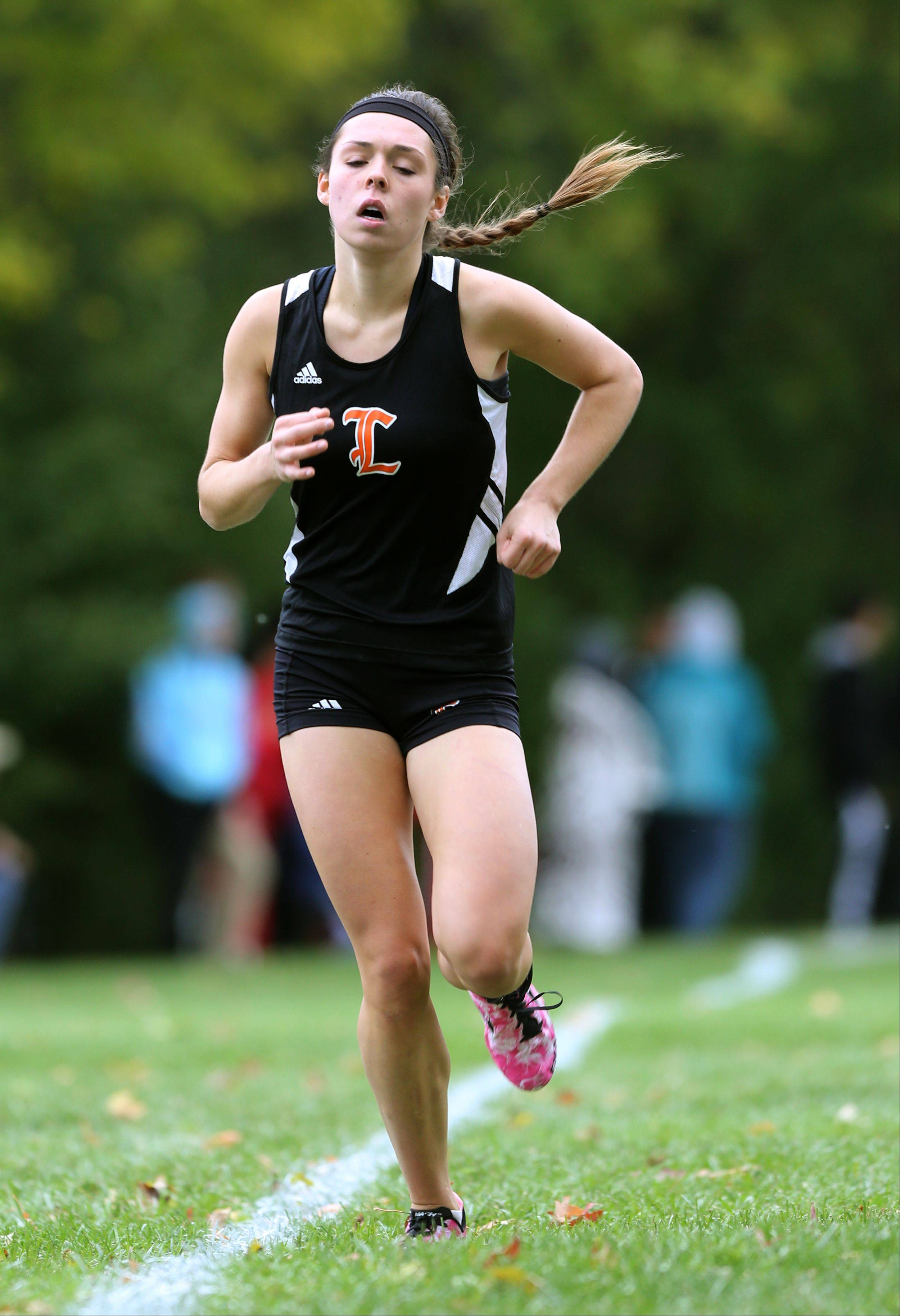 Libertyville's Ali Urbanski finishes the Class 3A Libertyville cross country regional at Adler Park.