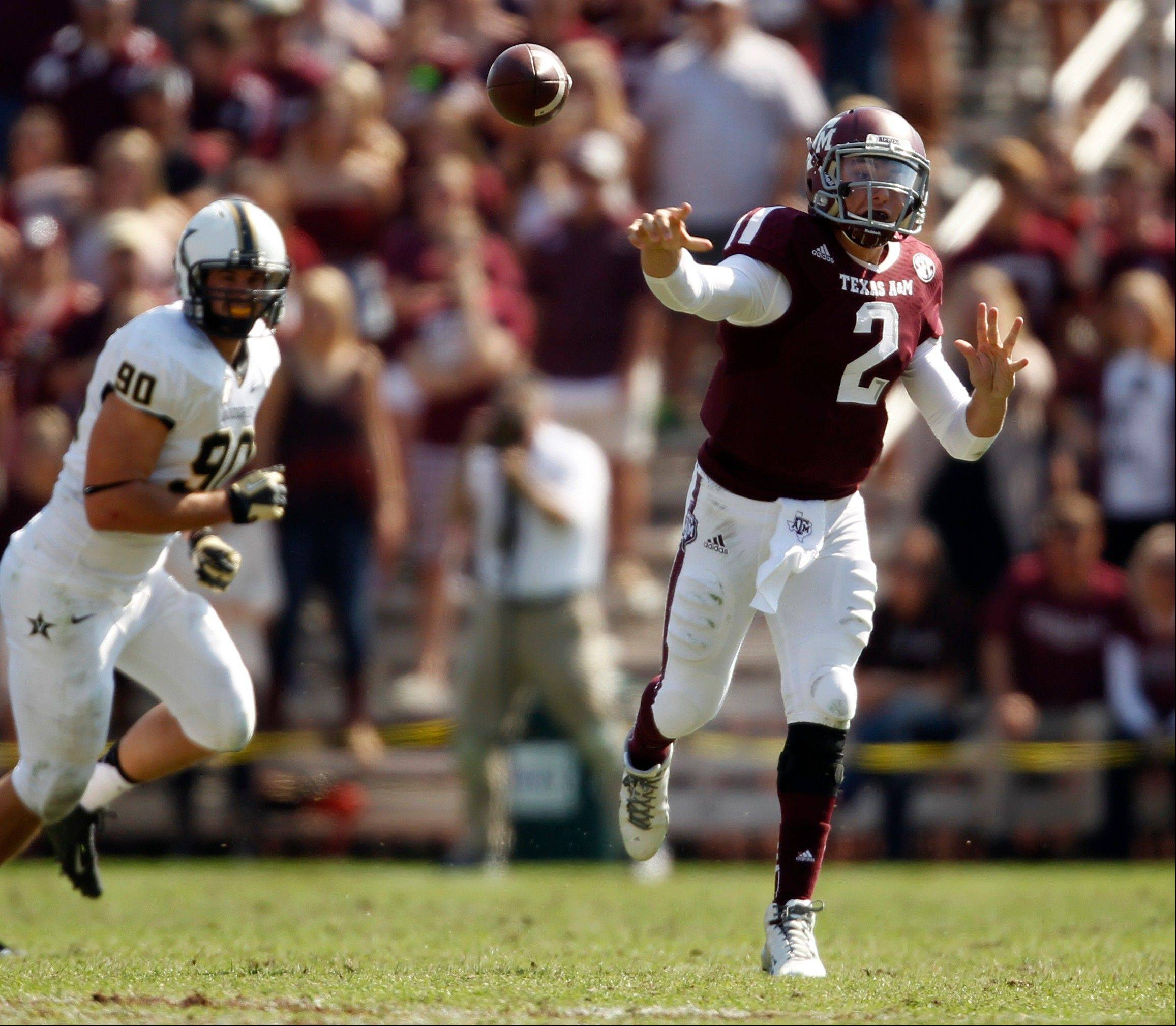 Texas A&M's Johnny Manziel (2) throws a pass during the first half.