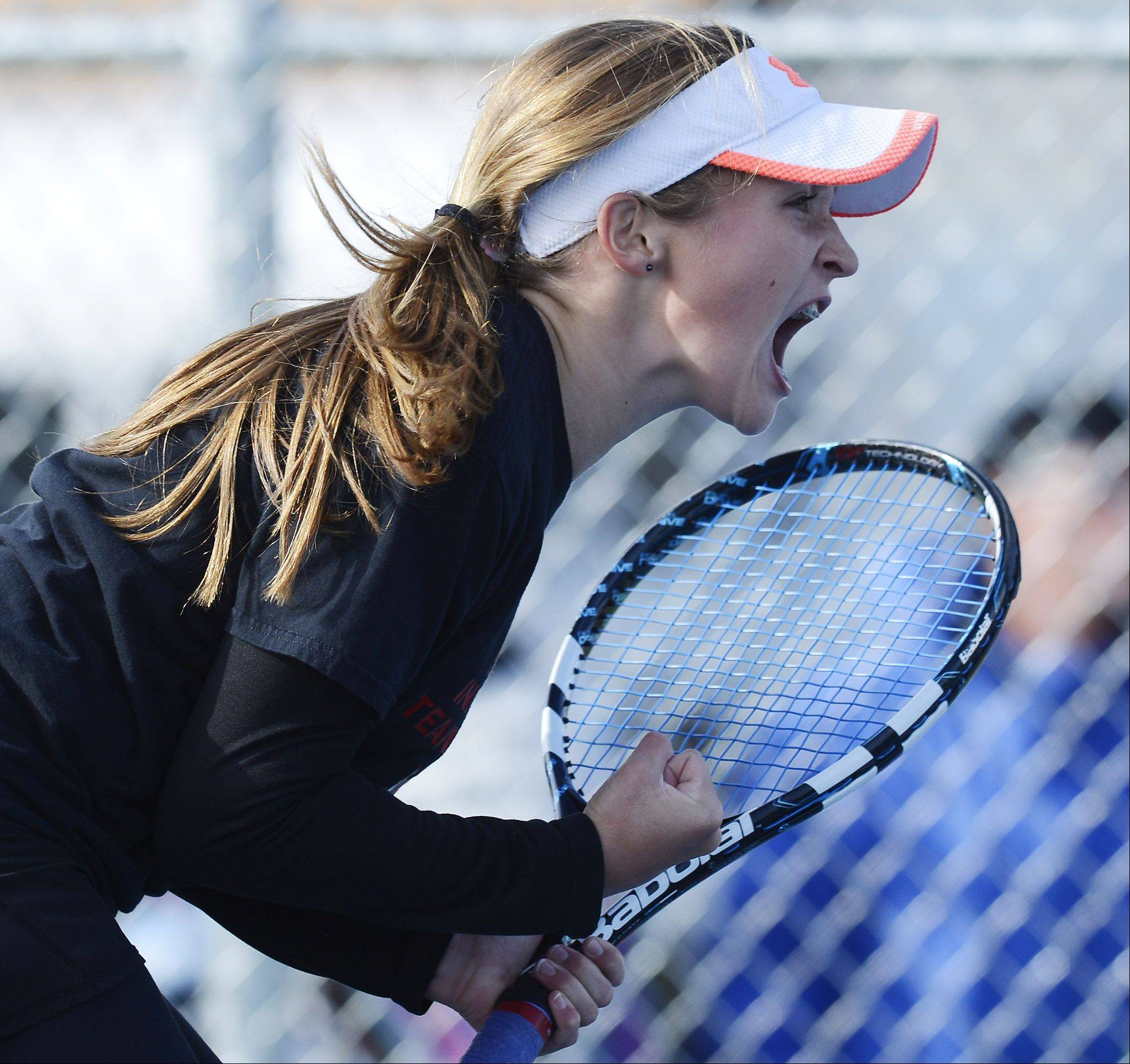 Hinsdale Central's Isabelle Lorenzini shows her competitive spirit as she earns a point during the girls state tennis semifinals at Buffalo Grove High School Saturday.