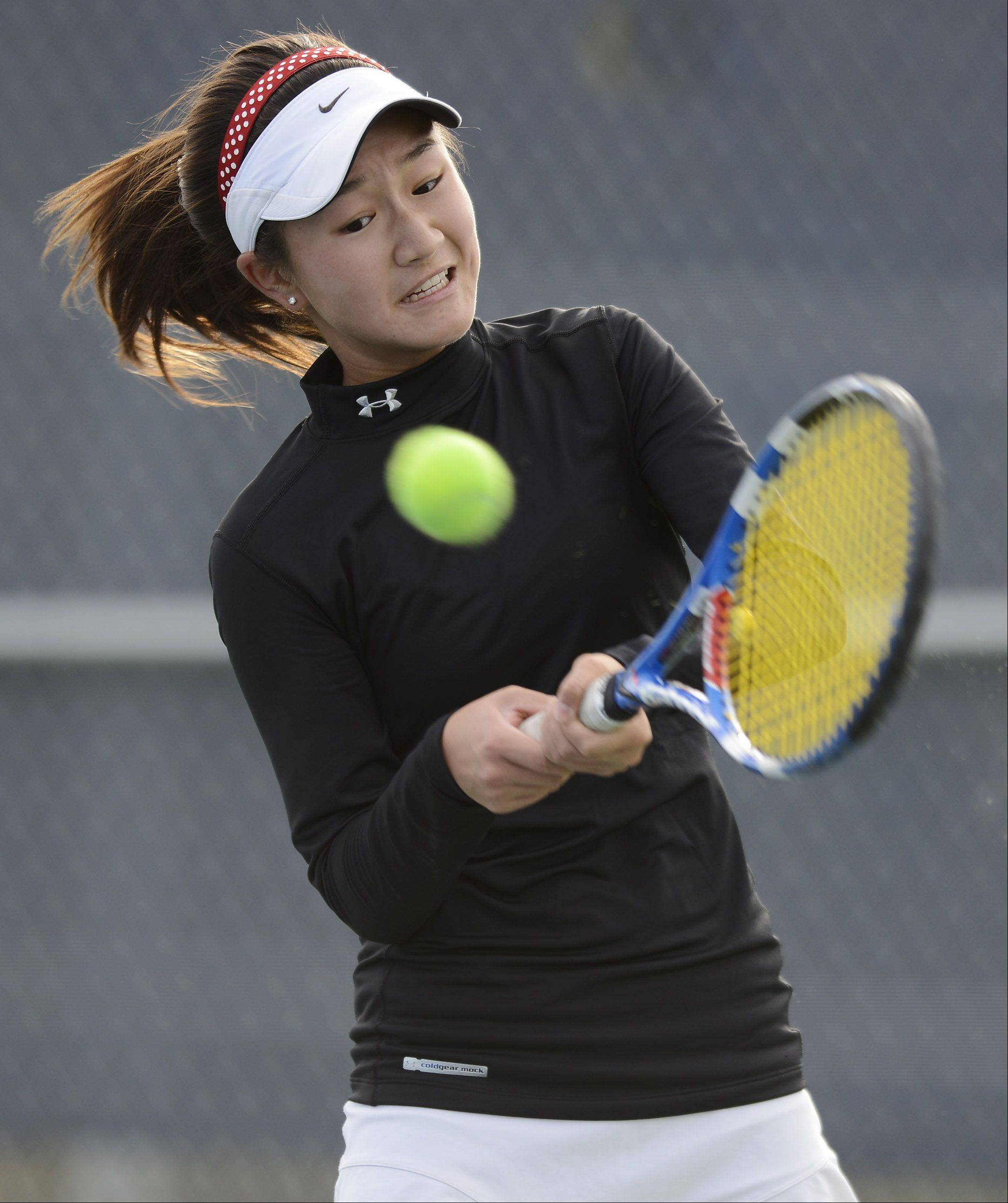 Naperville Central's Tiffany Chen returns a volley during the girls state tennis semifinals at Buffalo Grove High School Saturday.