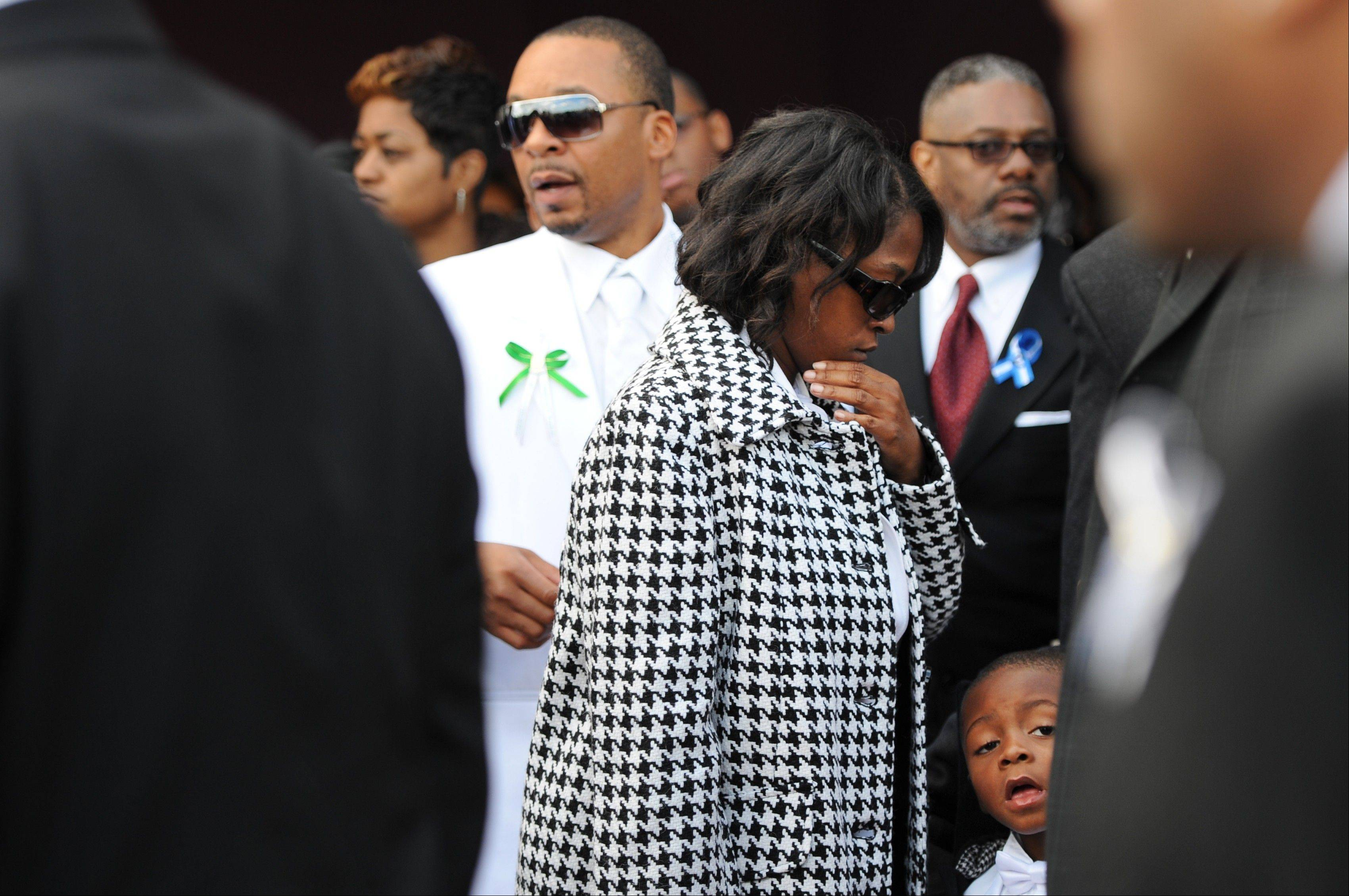 Tanesha Reed, center, stands in front of her husband, Carl, as they exit the church following a funeral service for her eldest son, Eastern Michigan football player, Demarius Reed at Holy Temple Cathedral in Harvey, Ill., on Saturday, Oct. 26, 2013. Reed was repeatedly shot Oct. 18 in what police say may have been a robbery. (AP Photo/AnnArbor.com, Melanie Maxwell) LOCAL TV OUT; LOCAL INTERNET OUT; ONLN OUT; IONLN OUT