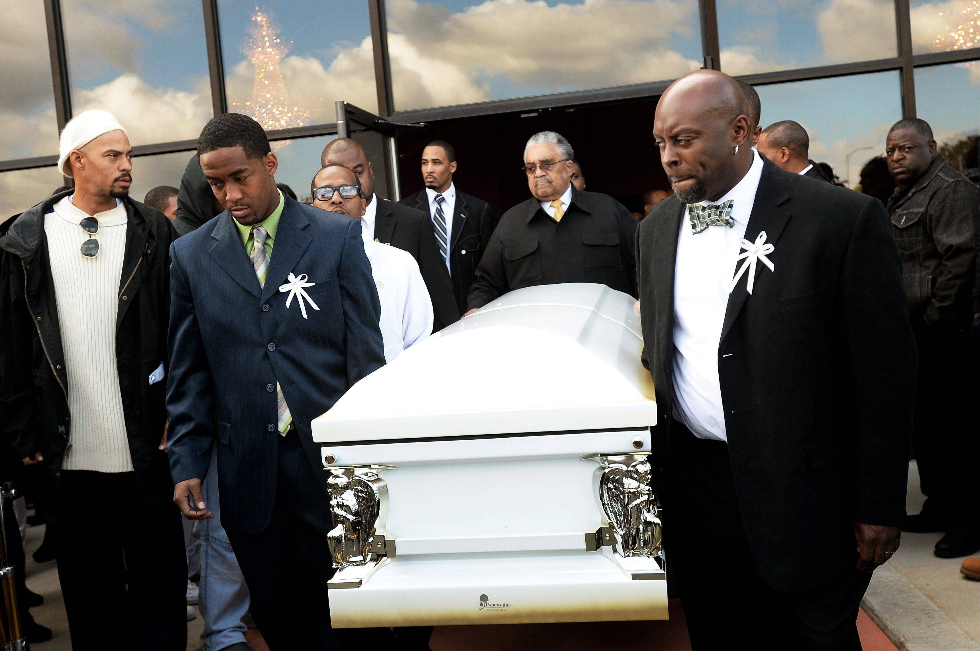 Pallbearers carry Eastern Michigan football player and Chicago native Demarius Reed's casket to a waiting hearse after his funeral at Holy Temple Cathedral in Harvey, Ill., on Saturday, Oct. 26, 2013. Reed was repeatedly shot Oct. 18 in what police say may have been a robbery. (AP Photo/AnnArbor.com, Melanie Maxwell) LOCAL TV OUT; LOCAL INTERNET OUT; ONLN OUT; IONLN OUT