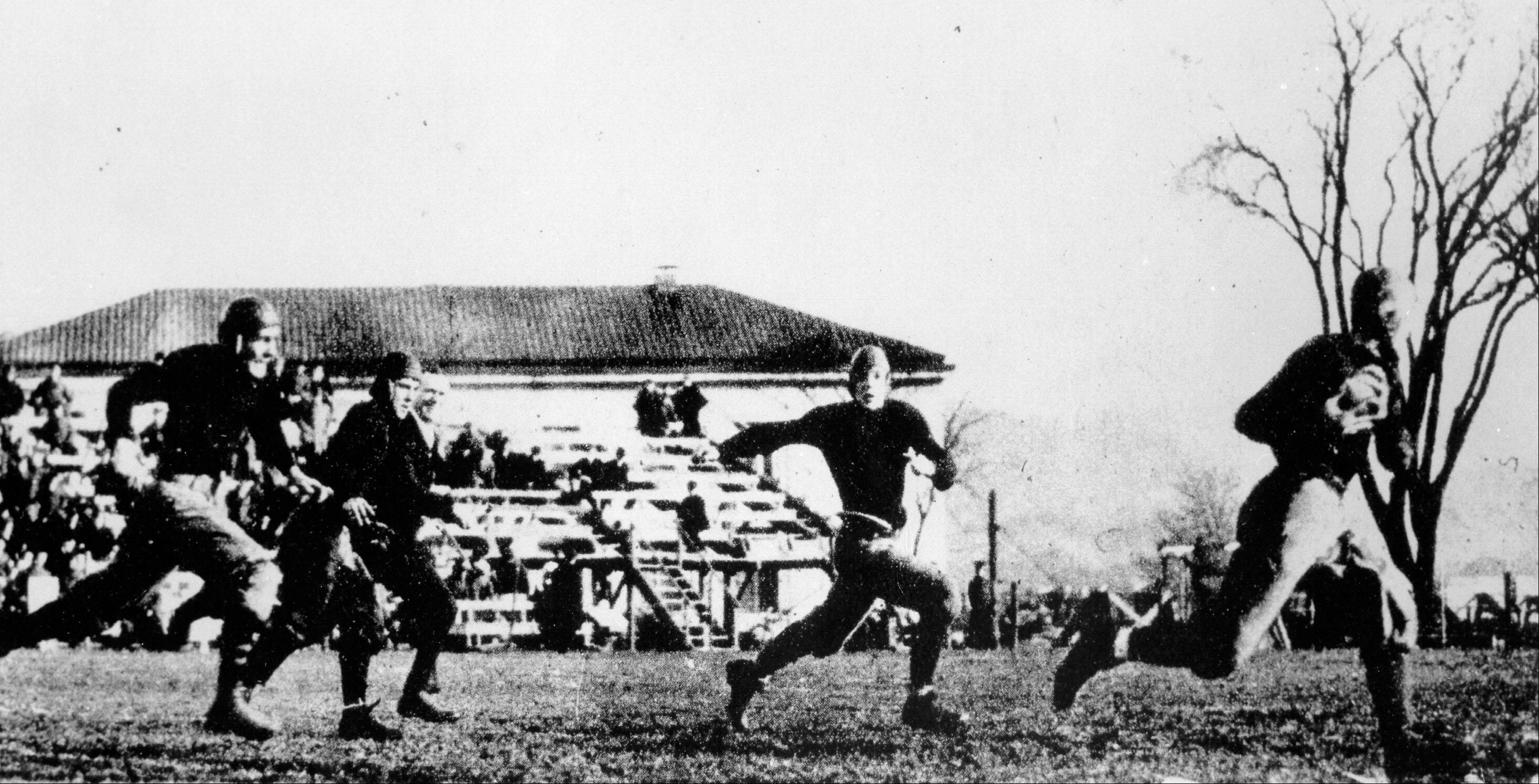 This Nov. 1, 1913, photo released by the University of Notre Dame shows Knute Rockne, right, making a touchdown against Army after catching a forward pass in West Point, N.Y.