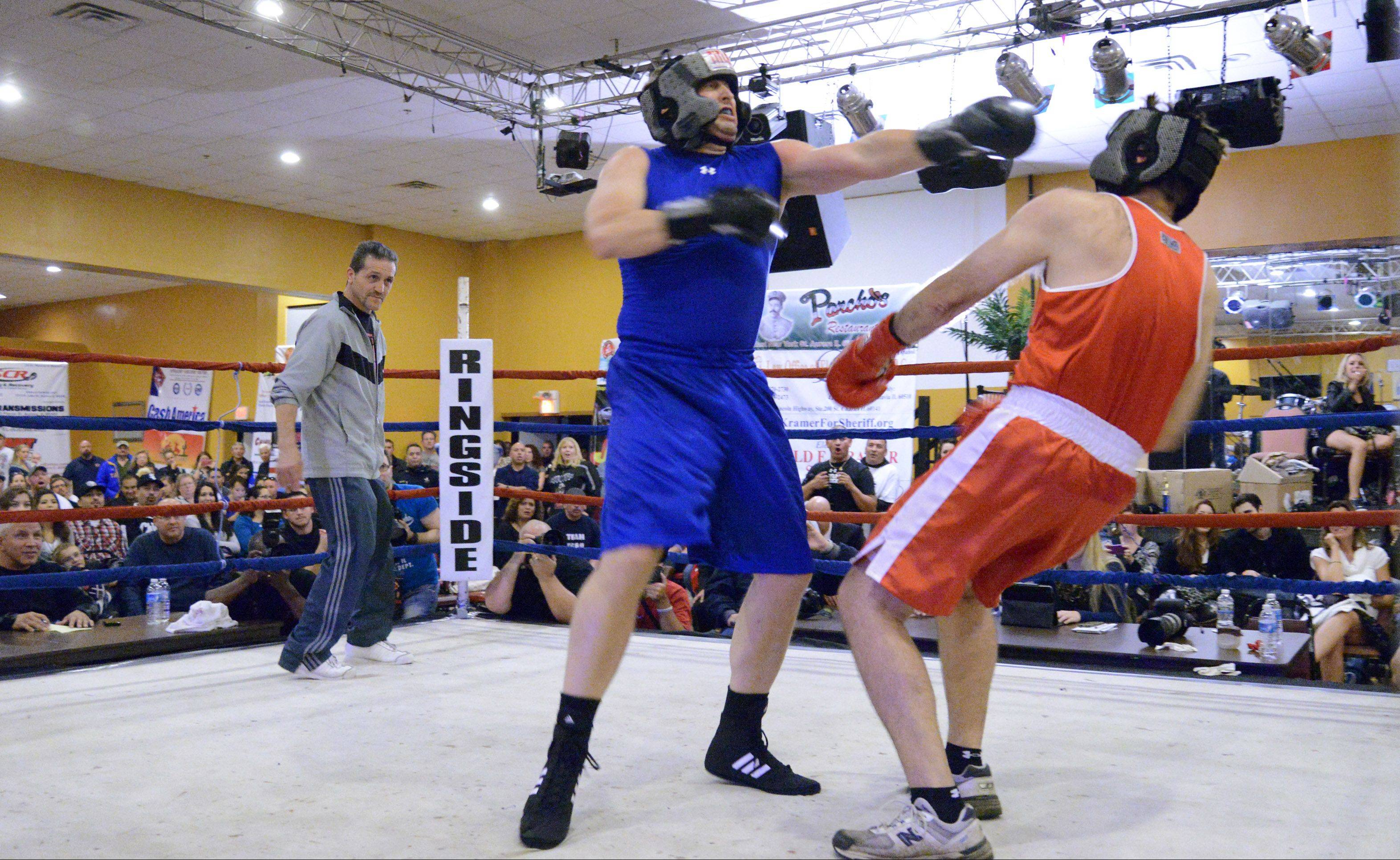 Cops, civic leaders punch it out for charity