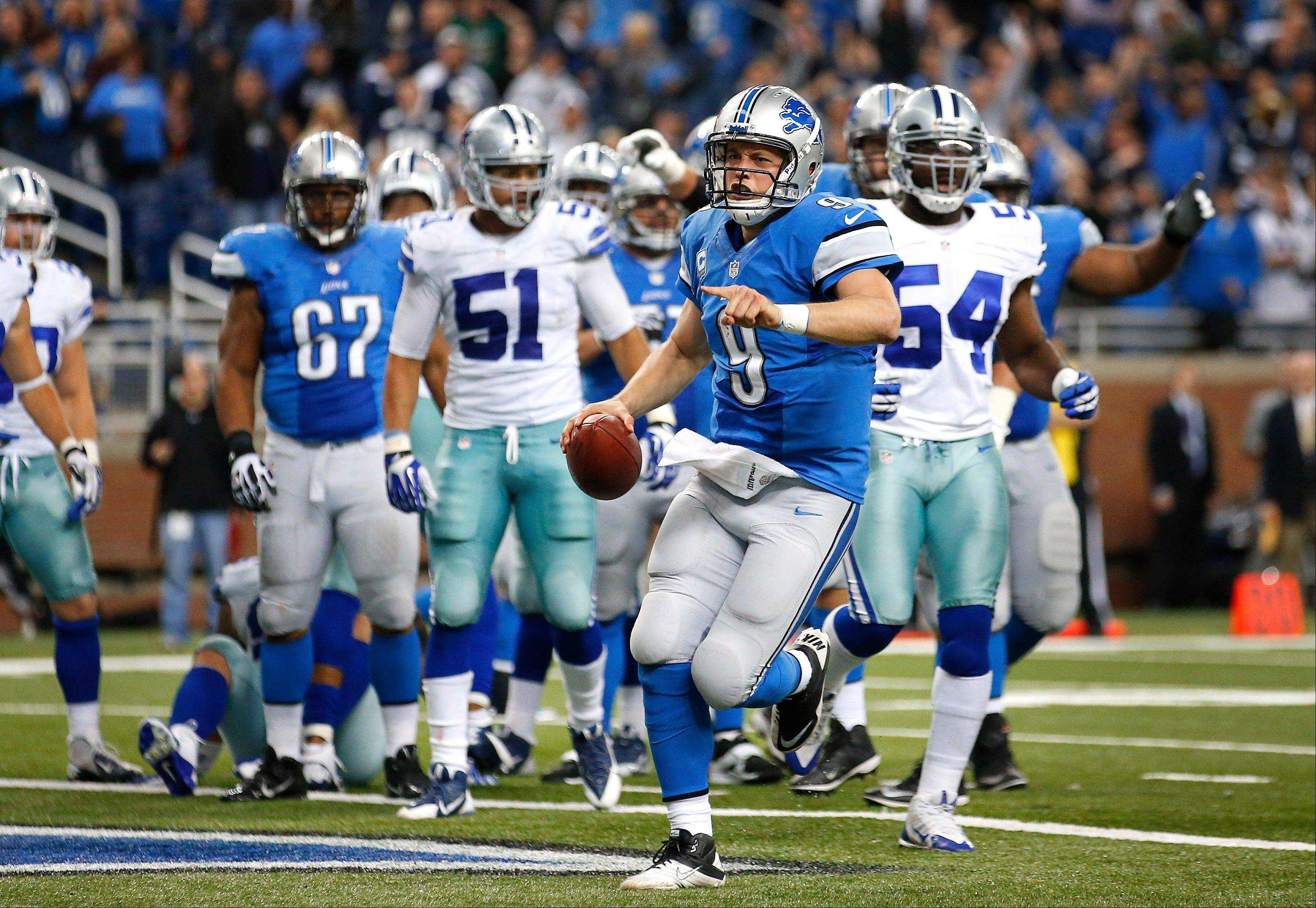 Detroit Lions quarterback Matthew Stafford (9) celebrates scoring on a 1-yard touchdown run against the Dallas Cowboys in the fourth quarter.