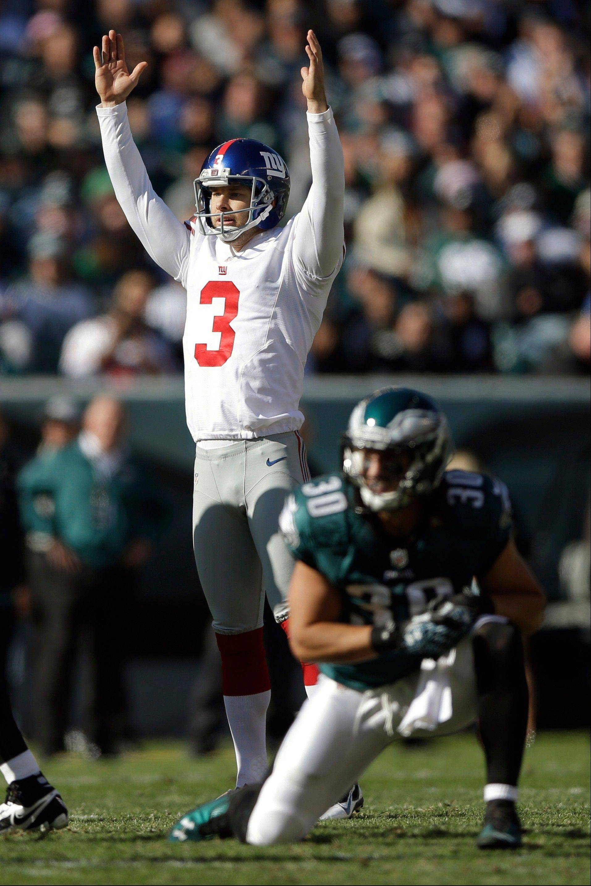 New York Giants kicker Josh Brown (3) celebrates as Philadelphia Eagles' Colt Anderson (30) reacts after Brown kicked a field goal during the first half.