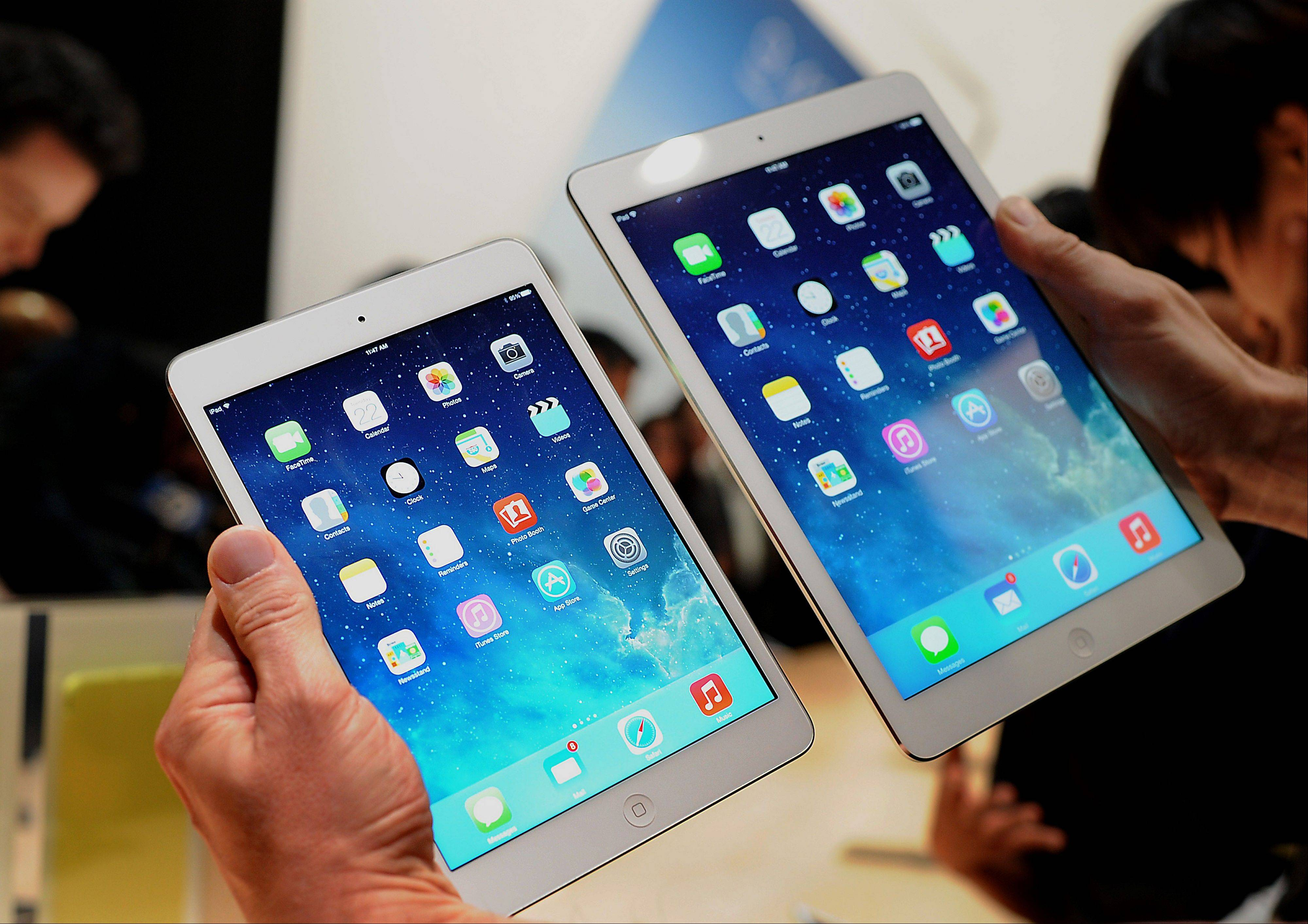 Apple Inc. introduced new iPads in time for holiday shoppers, as it battles to stay ahead of rivals in the increasingly crowded market for tablet computers.