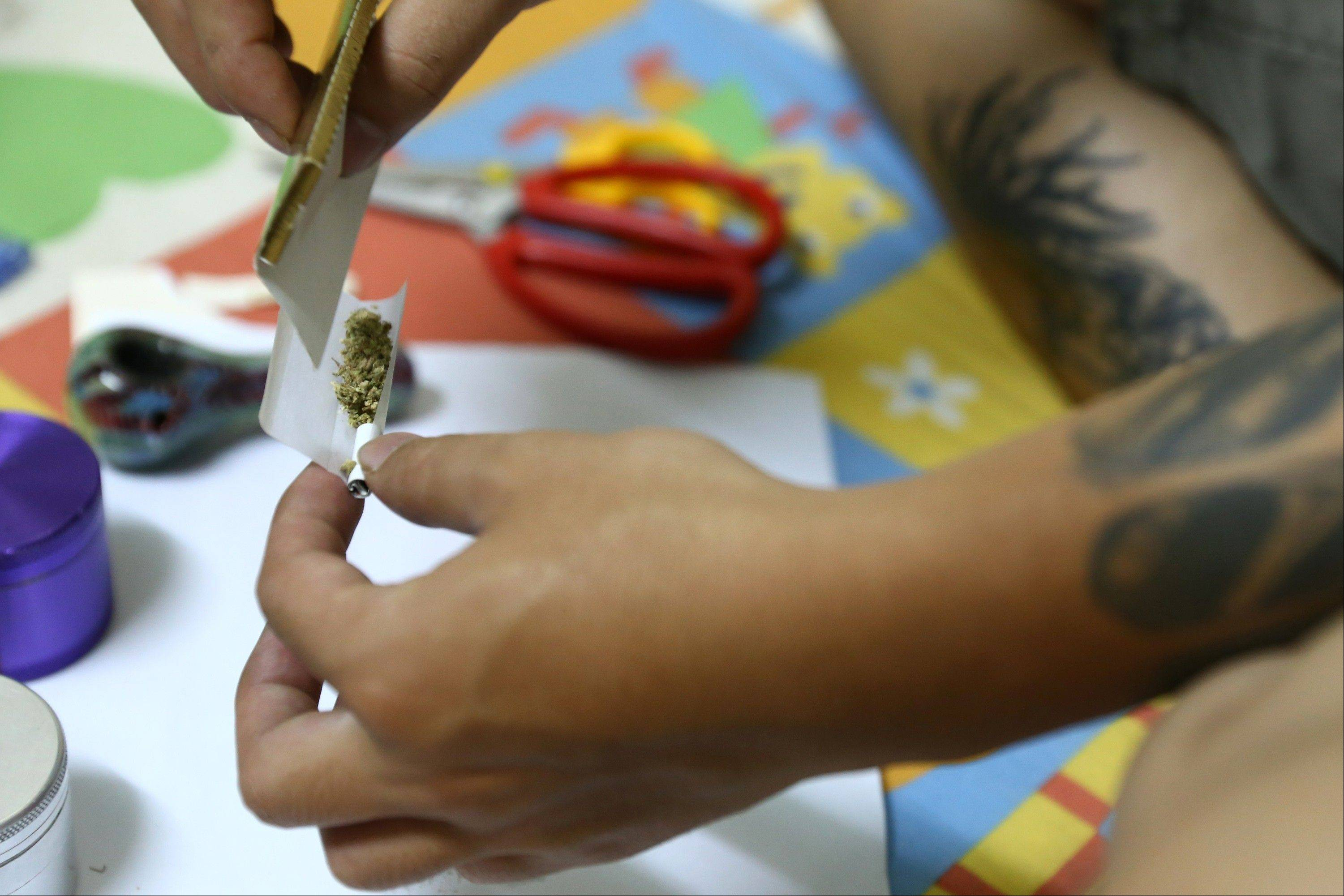 A man rolls a joint with Canadian-grown marijuana at his room in the old quarter area of Hanoi. Western-grown marijuana is available in Vietnam and popular among its elite, a result of its passion for imported products and the widespread involvement of Vietnamese diaspora gangs in the cultivation of marijuana in North America and Europe.