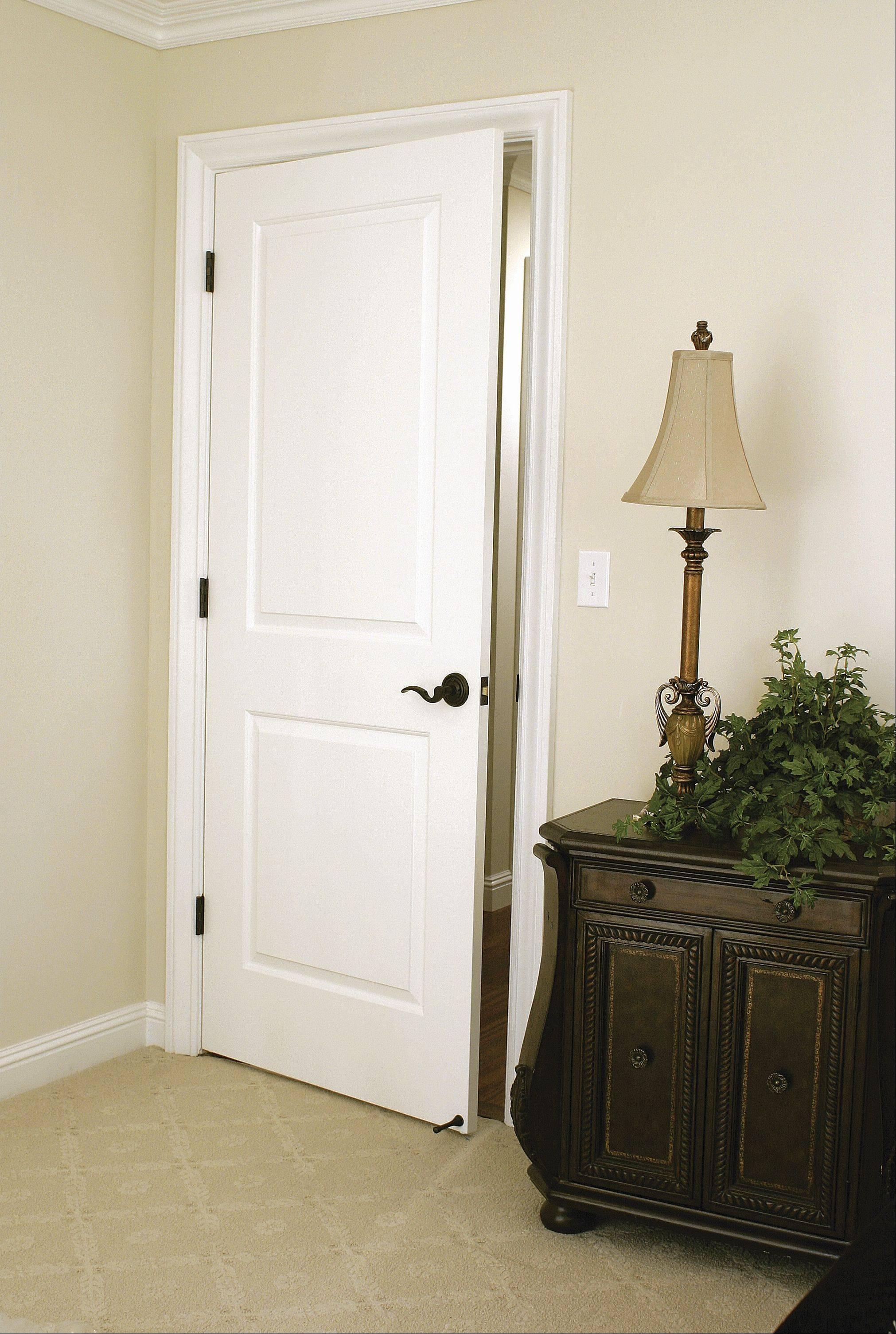 A two-panel door with decorative hardware can give a room an updated look.