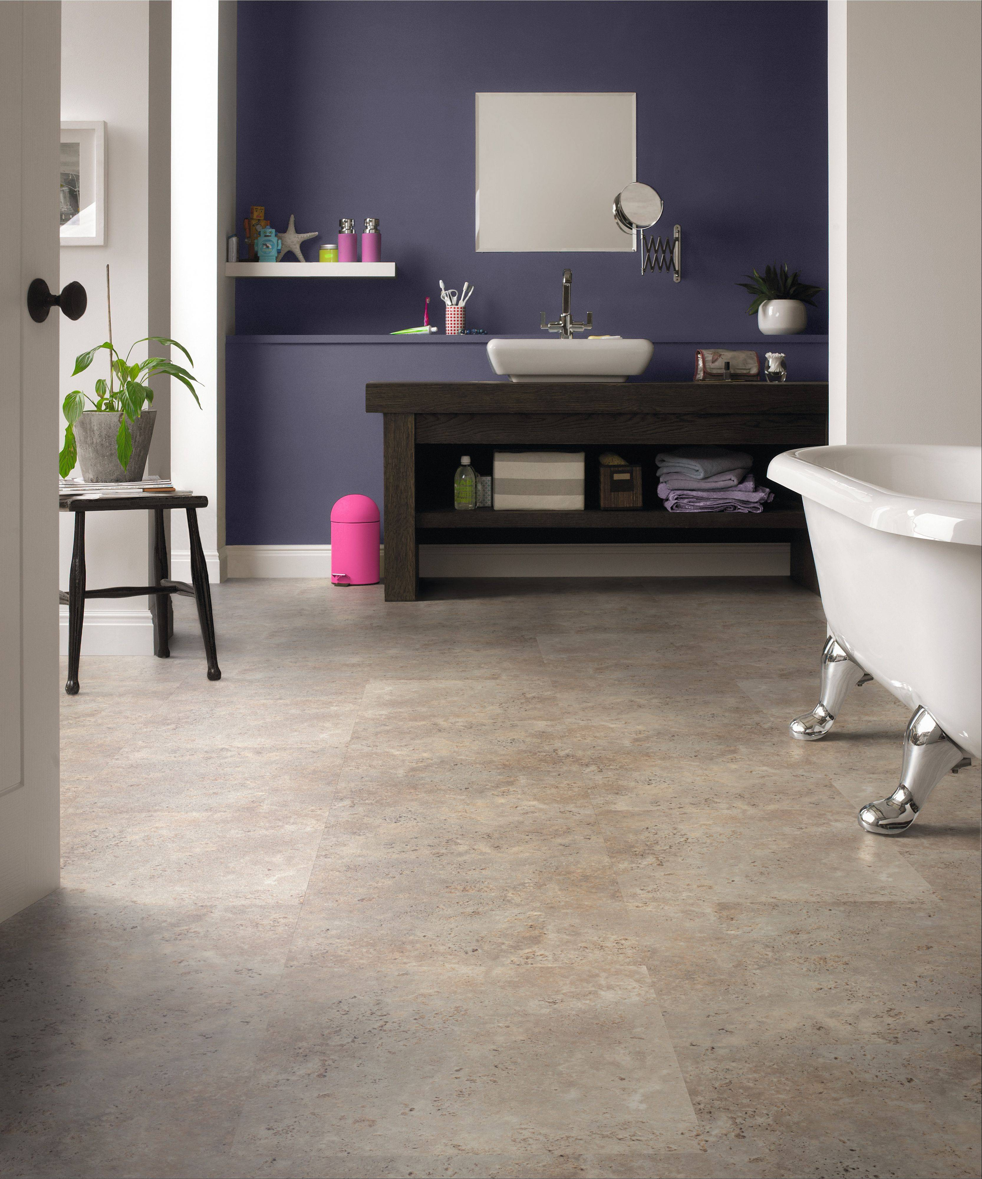 Karndean tile, in addition to the realistic look of wood or stone, also provides ease of installation and protection from devastation because the tile does not have to be glued in place. It has a nonskid backing that allows it to stay in place without being permanently installed.