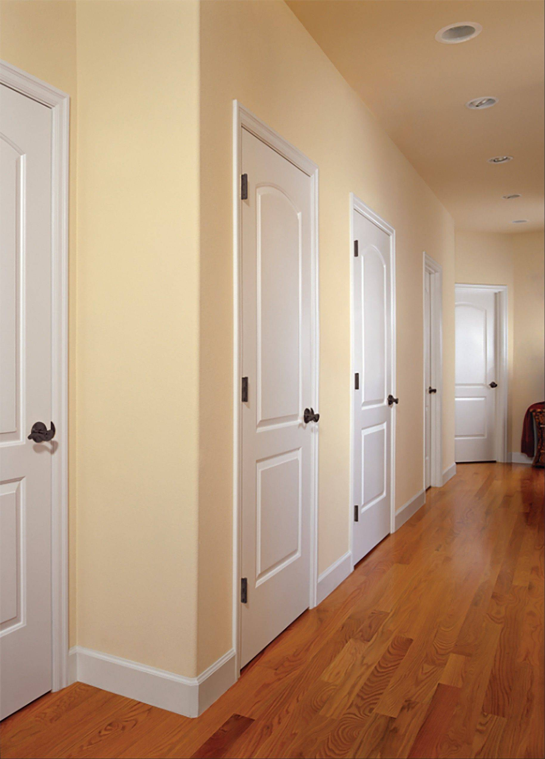 Here is the after picture of a customer's makeover with new white doors and trim from HomeStory Chicago.