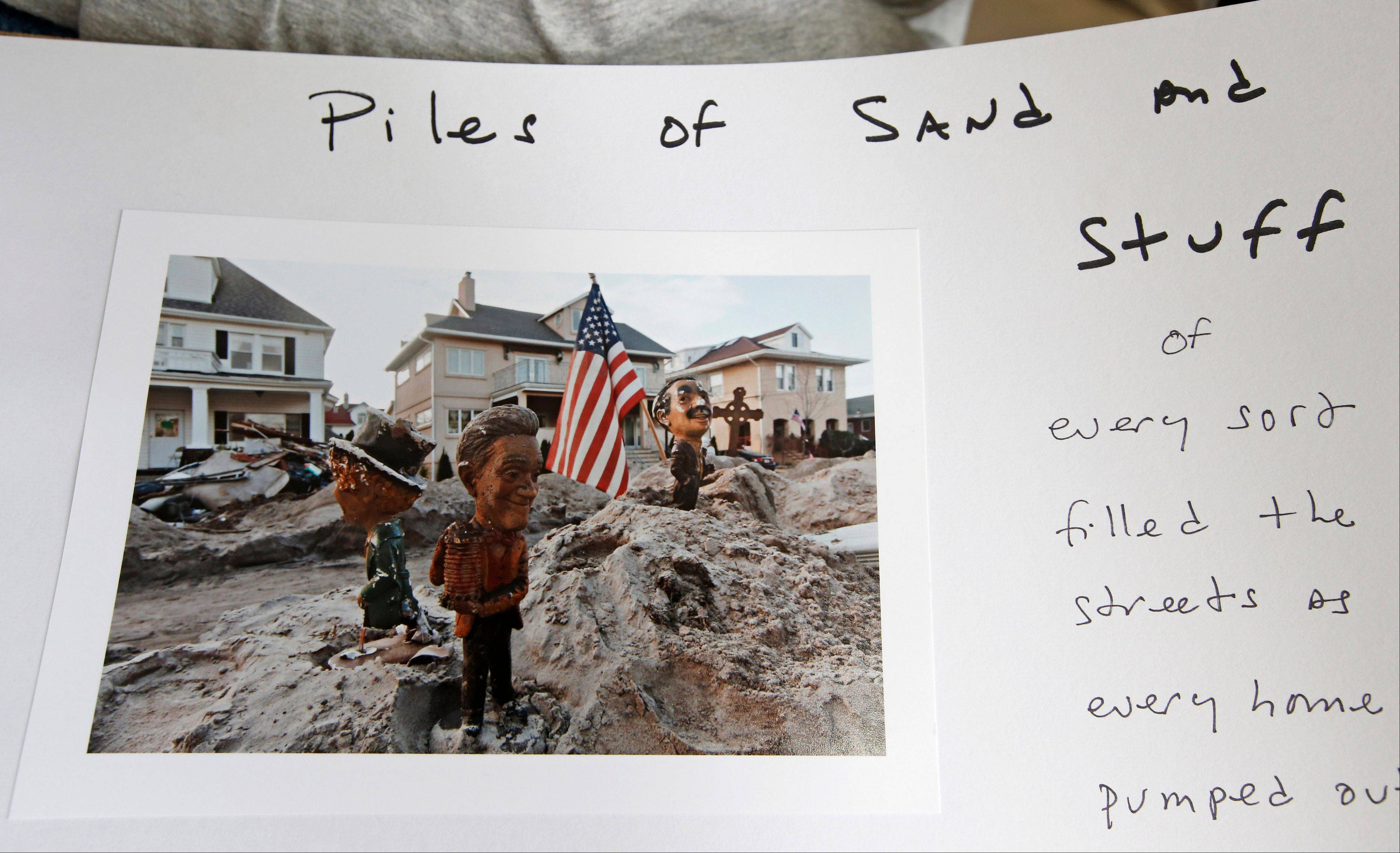 "Larry Racioppo shows a page from his personal Superstorm Sandy photo album that will be part of the exhibition ""Rising Waters: Photographs of Sandy"" that opens Tuesday, Oct. 29, at the Museum of the City of New York."