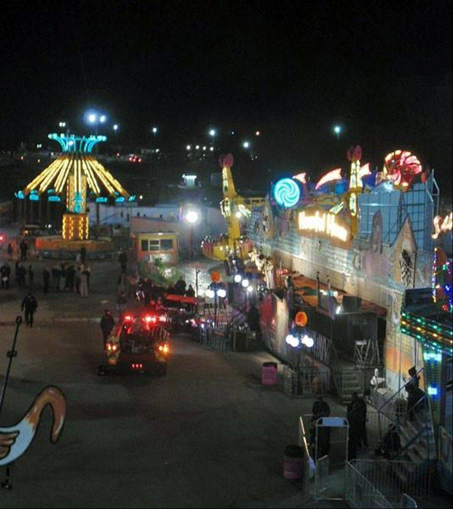 Emergency crews respond to the scene where a ride malfunctioned Thursday at the North Carolina State Fair.