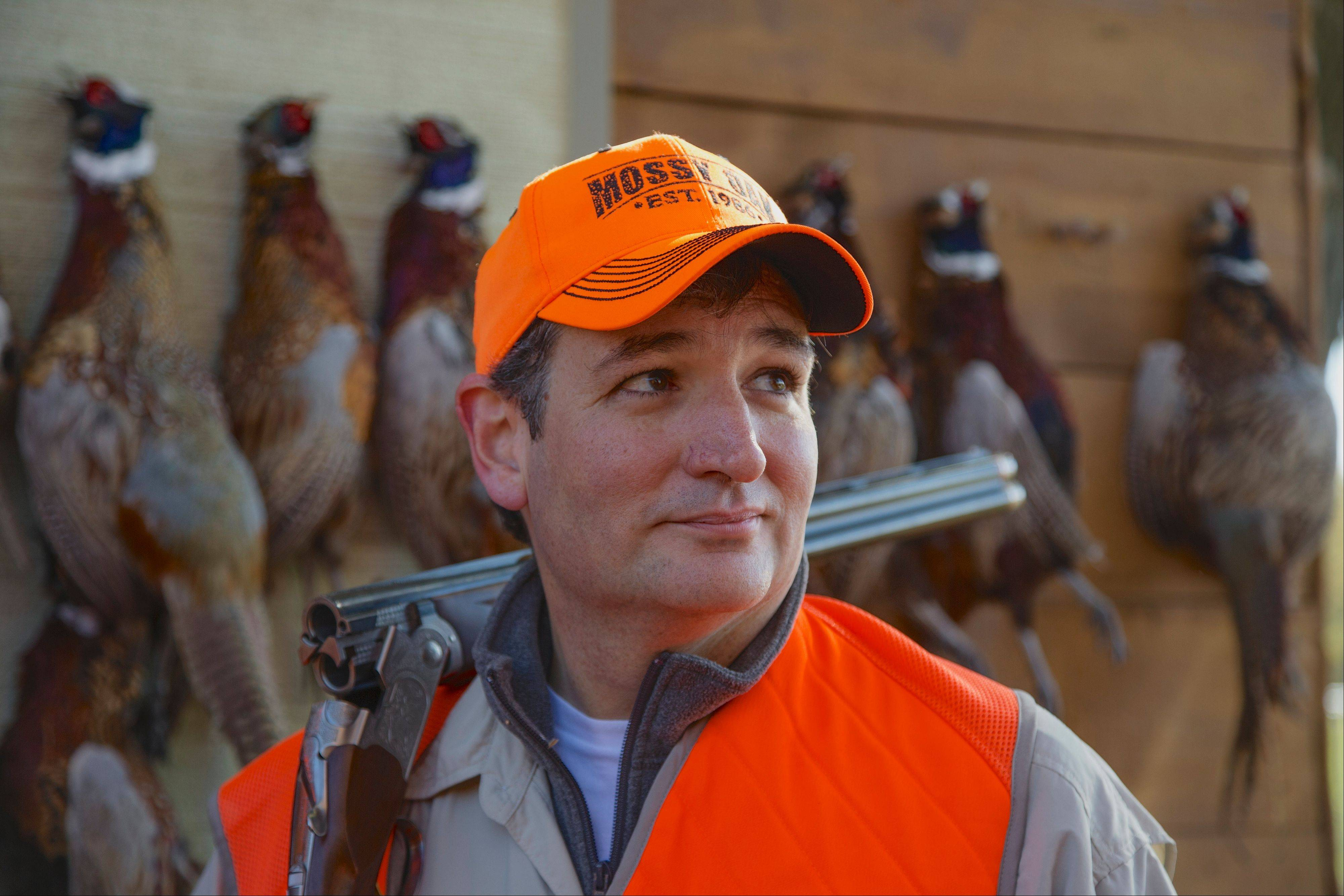 Sen. Ted Cruz stands in front of pheasants that were shot during a hunt hosted by Rep. Steve King on Saturday in Akron, Iowa. Cruz attended the Iowa GOP's annual fundraising dinner in Des Moines on Friday.