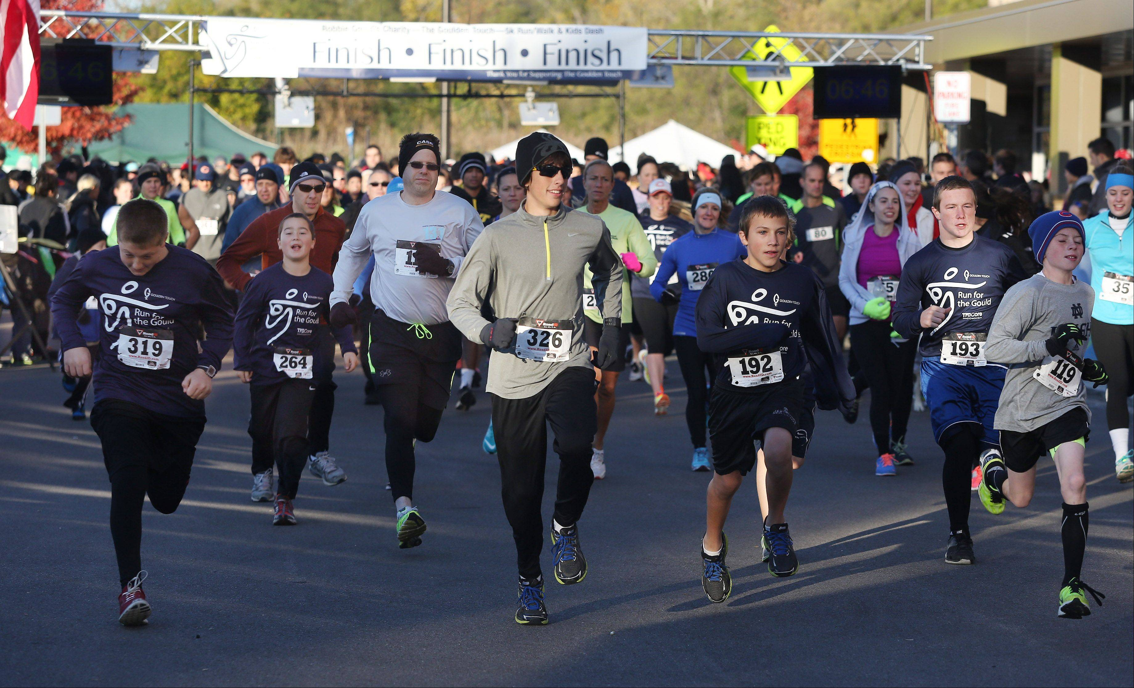 Runners start the Run for the Gould 5K and Kids Dash in Kildeer. Chicago Bears kicker Robbie Gould and TruCore Pilates sponsored the run to benefit the Goulden Touch charity, which donates money to food banks, cancer research and other causes.