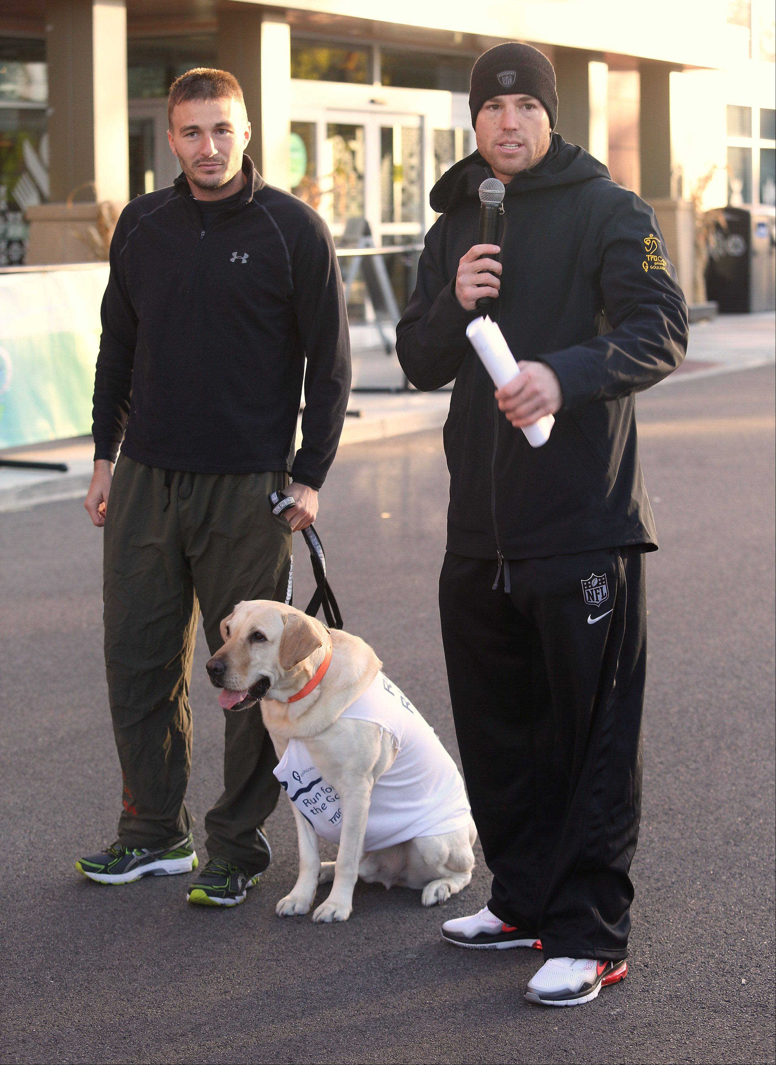 Chicago Bears kicker Robbie Gould introduces former Marine Tim Monsen and his dog Chance on Sunday during the Run for the Gould 5K and Kids Dash in Kildeer. Gould and TruCore Pilates sponsored the run to provide funds to the Goulden Touch charity that donates money to wounded soldier organizations, food banks, cancer research and other causes.