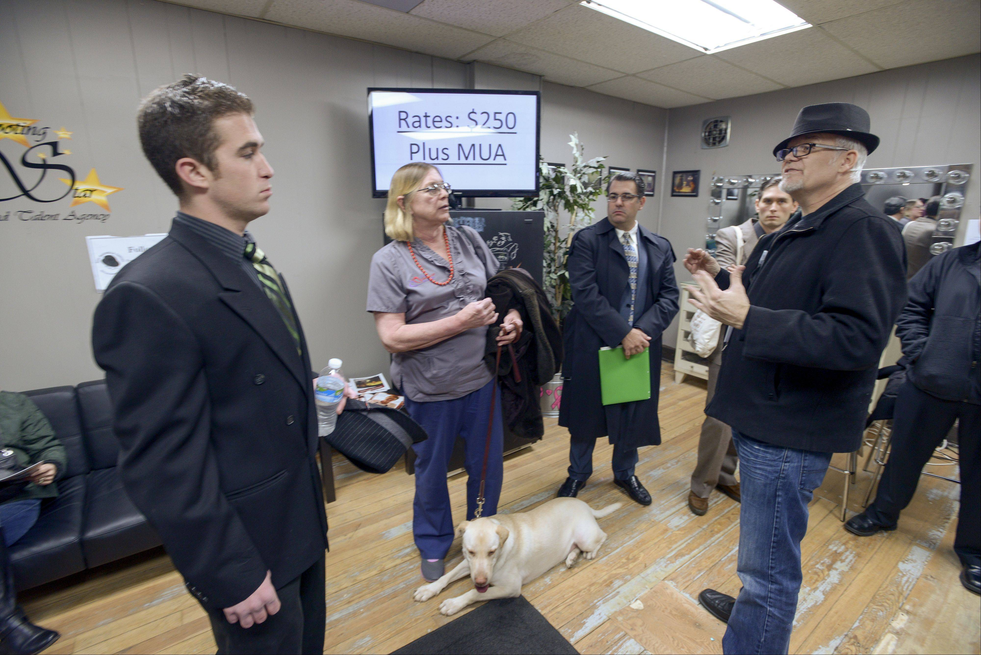 "Bill Marinella, right, casting director for background actors for the upcoming show ""Chicago PD,"" talks with some of the would-be actors who attended an open casting call for extras Sunday at Shooting Star Studios in St. Charles."