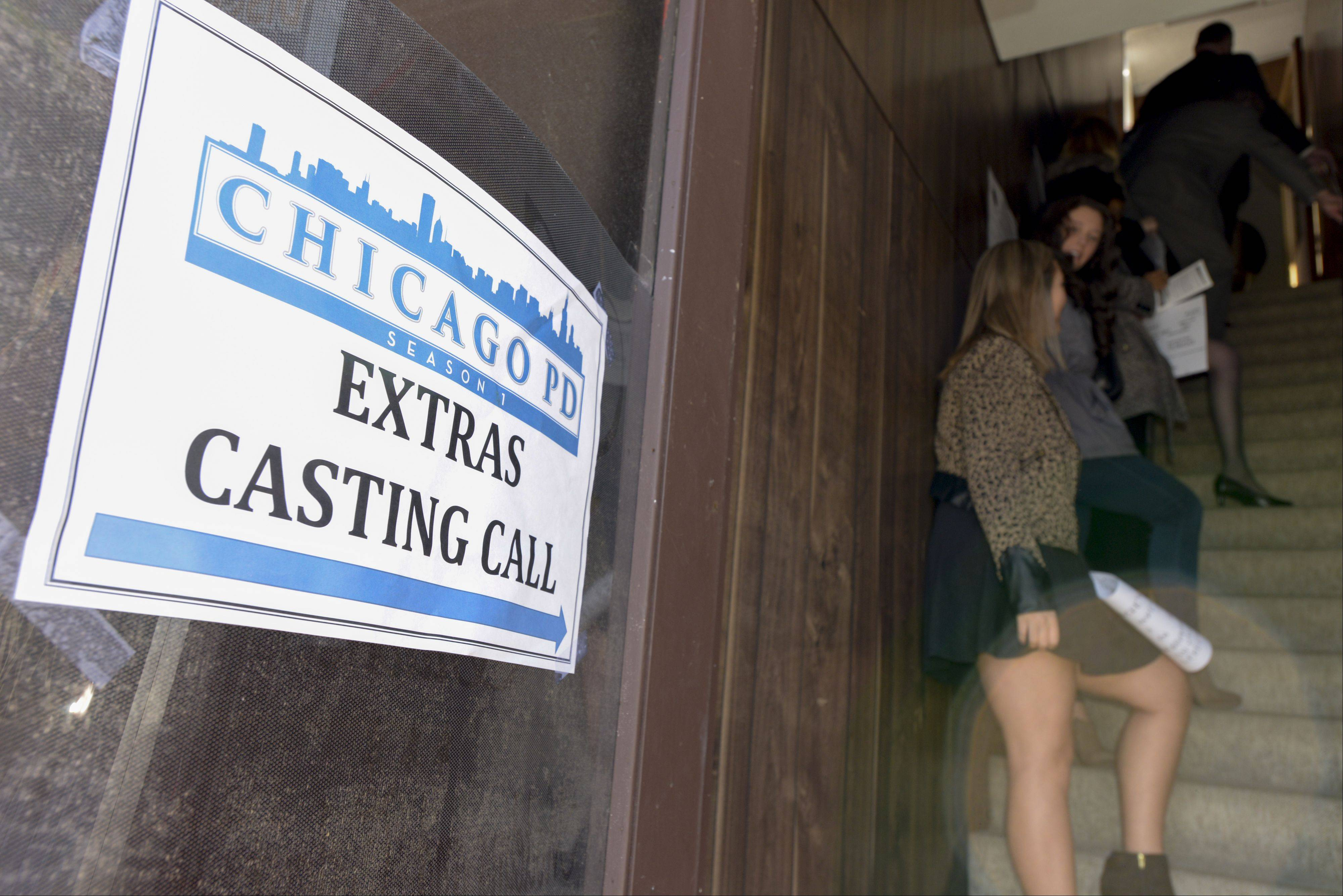 "The line for those interested in getting a background role on the upcoming NBC TV show ""Chicago PD"" stretched down the stairs during the open casting call for extras Sunday at Shooting Star Studios in St. Charles."