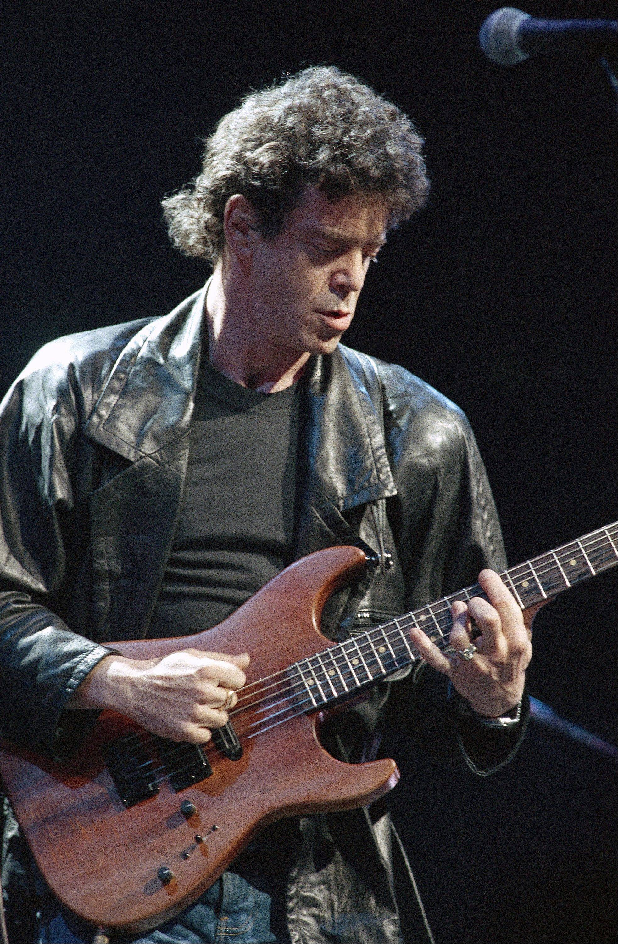 In a June 13, 1986, file photo, Lou Reed performs during musical number at a benefit in Chicago, for Amnesty International. Reed's literary agent Andrew Wylie says the legendary musician died Sunday morning.