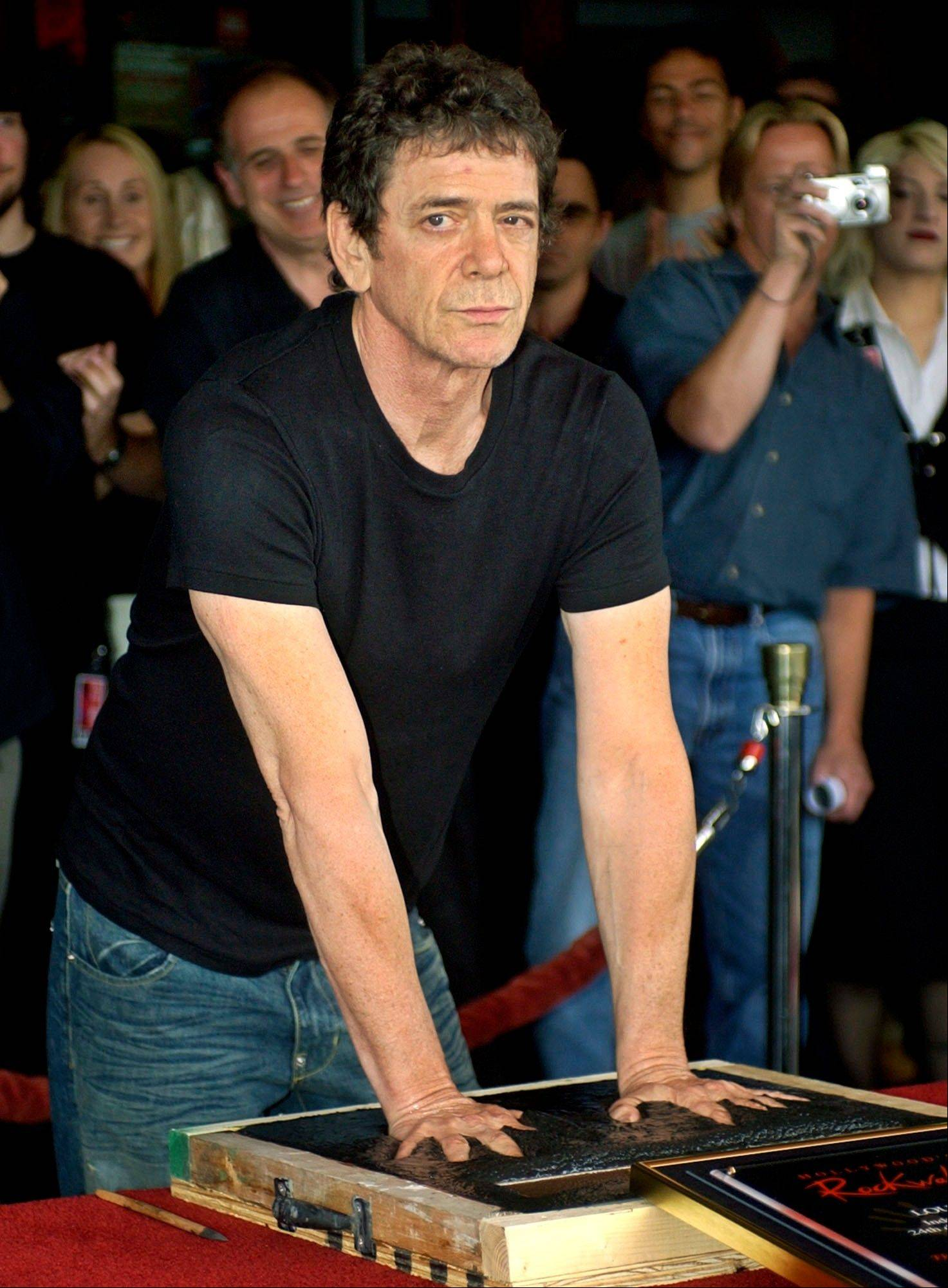 On June 24, 2003, Lou Reed has his hands imprinted as he is inducted into Hollywood's Rockwalk, in the Hollywood section of Los Angeles.