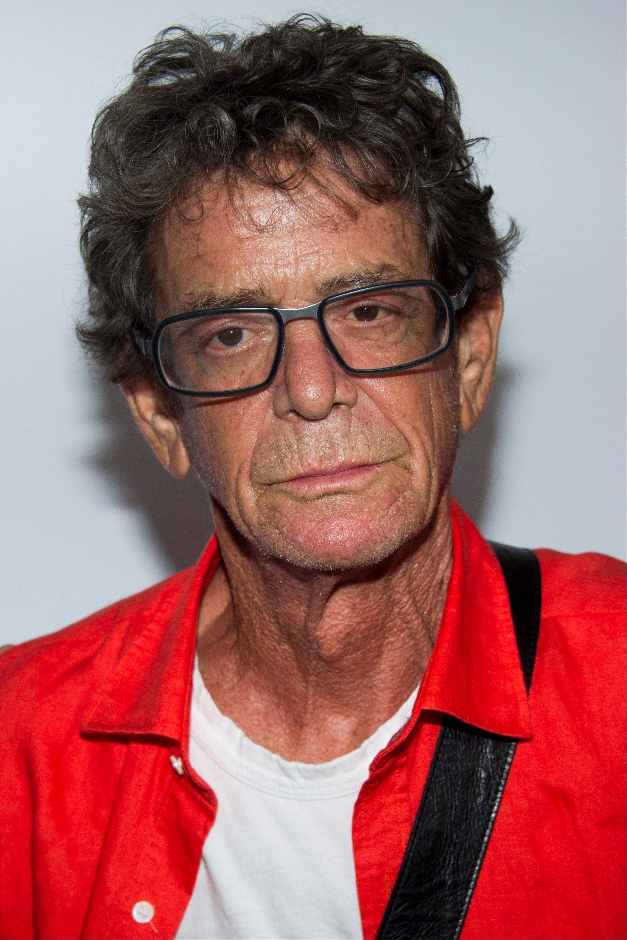 "In a Wednesday, July 31, 2013, file photo, Lou Reed attends the ""Breaking Bad"" final episodes premiere hosted by the Film Society of Lincoln Center in New York. Punk-poet, rock legend Lou Reed is dead of a liver-related ailment, his literary agent said Sunday."