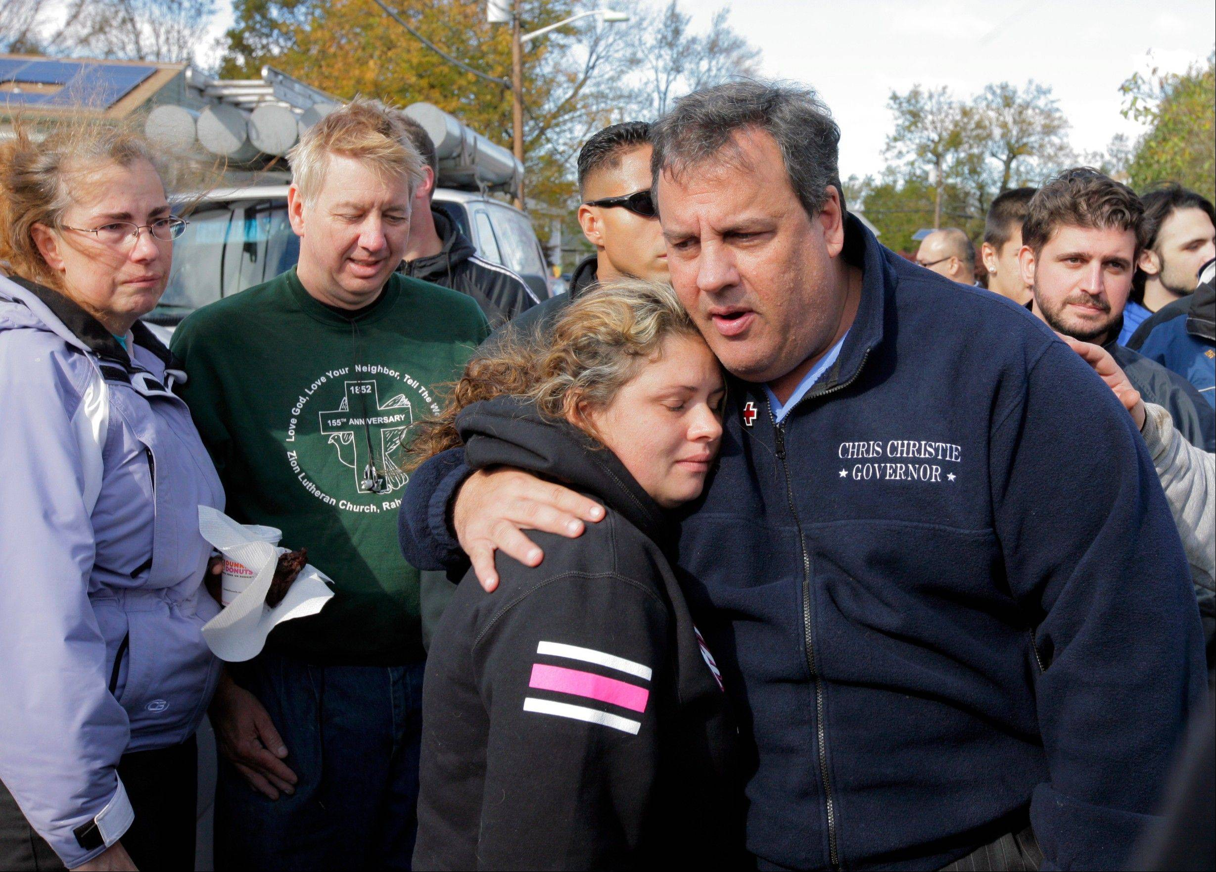 New Jersey Gov. Chris Christie comforts Kerri Berean, 33. Christie was in many ways the face of the storm, whether he was embracing President Barack Obama during a visit to the battered coast or consoling a tearful 9-year-old girl who had lost her house and told the governor she was scared. A year later though, some of his admirers have become detractors.
