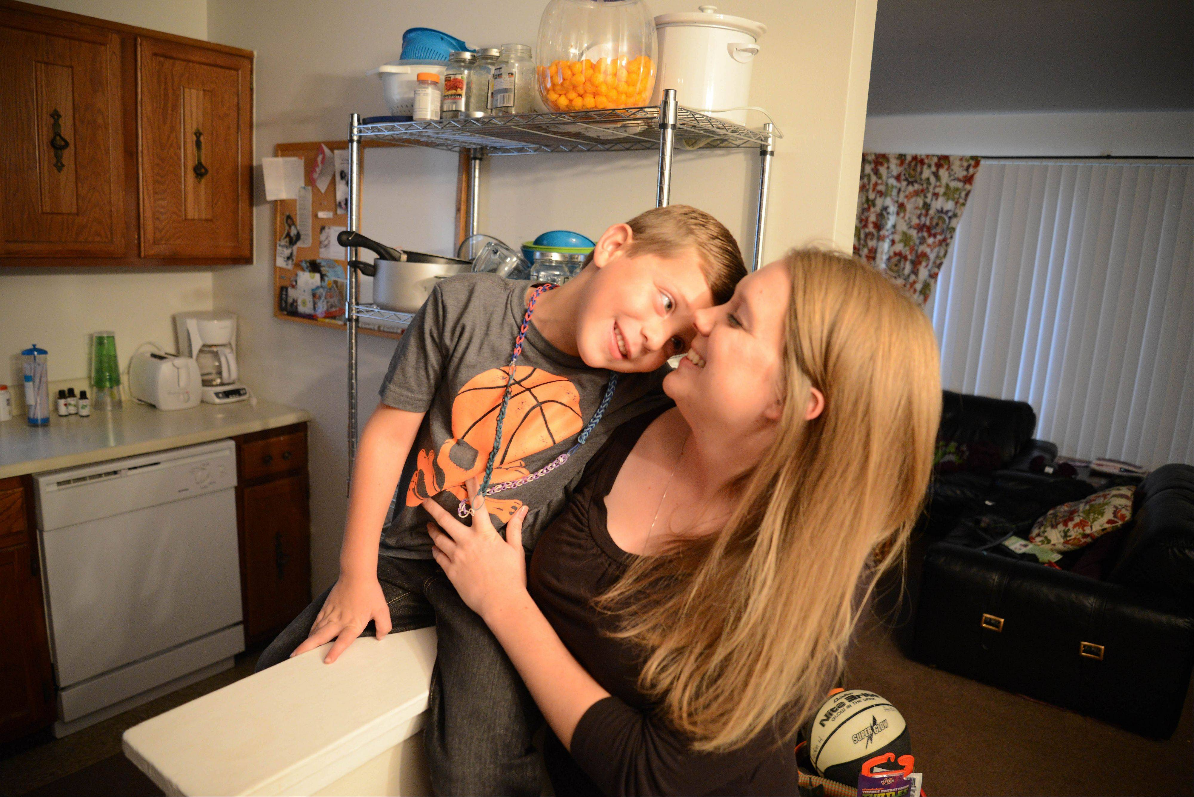 The help that Bridge Communities provided to Alecia Hannemann helped her get a Carol Stream apartment and build up her savings. She says the most important thing is that her 6-year-old son, Aidan, is happy.