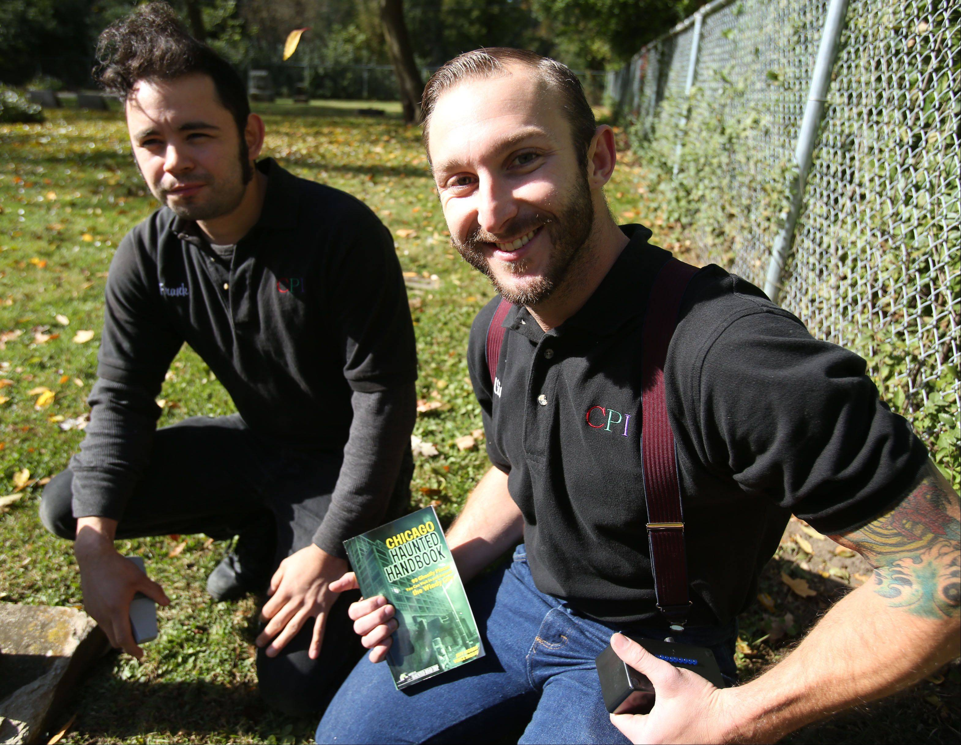 "Holding the ""Chicago Haunted Handbook"" listing ""99 ghostly places"" in the city and suburbs, former Elgin and Huntley resident Vince Sheilds, right, visits White Cemetery near Barrington with Frank Rosko, another member of the Chicago Paranormal Investigators team."