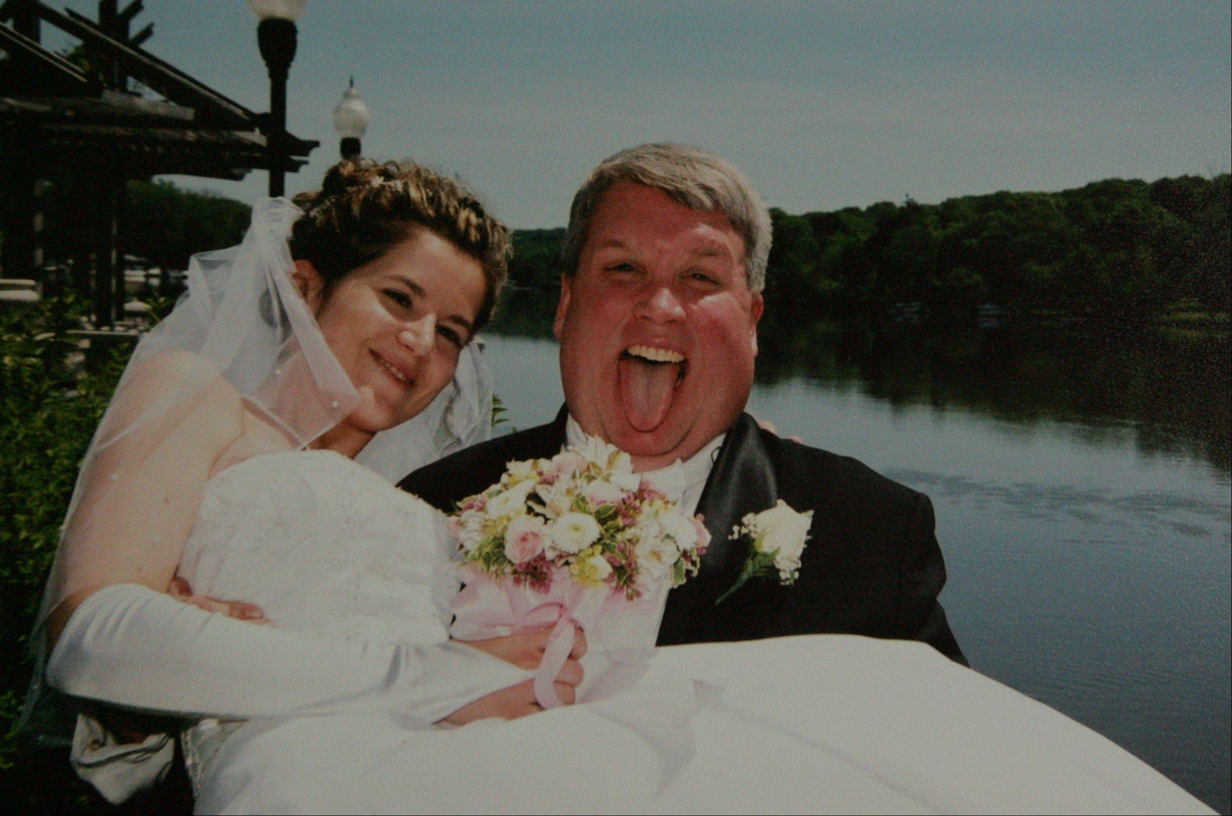 "Frank and Jenny Russo on their wedding day. ""That (expression) is so Frank,"" Jenny said."