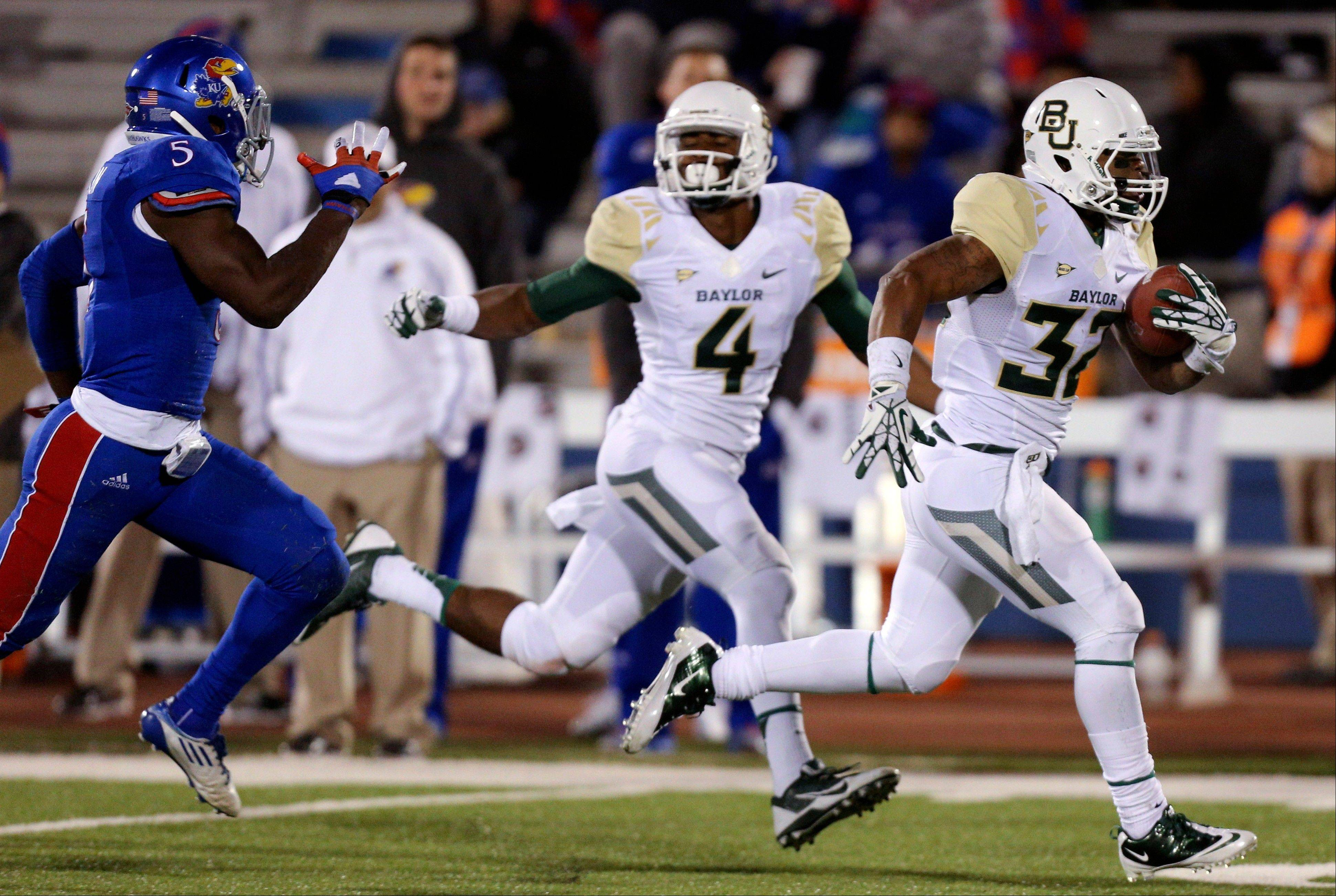 Baylor Bears running back Shock Linwood (32) runs past Kansas Jayhawks safety Isaiah Johnson (5) for a touchdown run in the fourth quarter of an NCAA college football game Saturday in Lawrence, Kan. Baylor won 59-14.