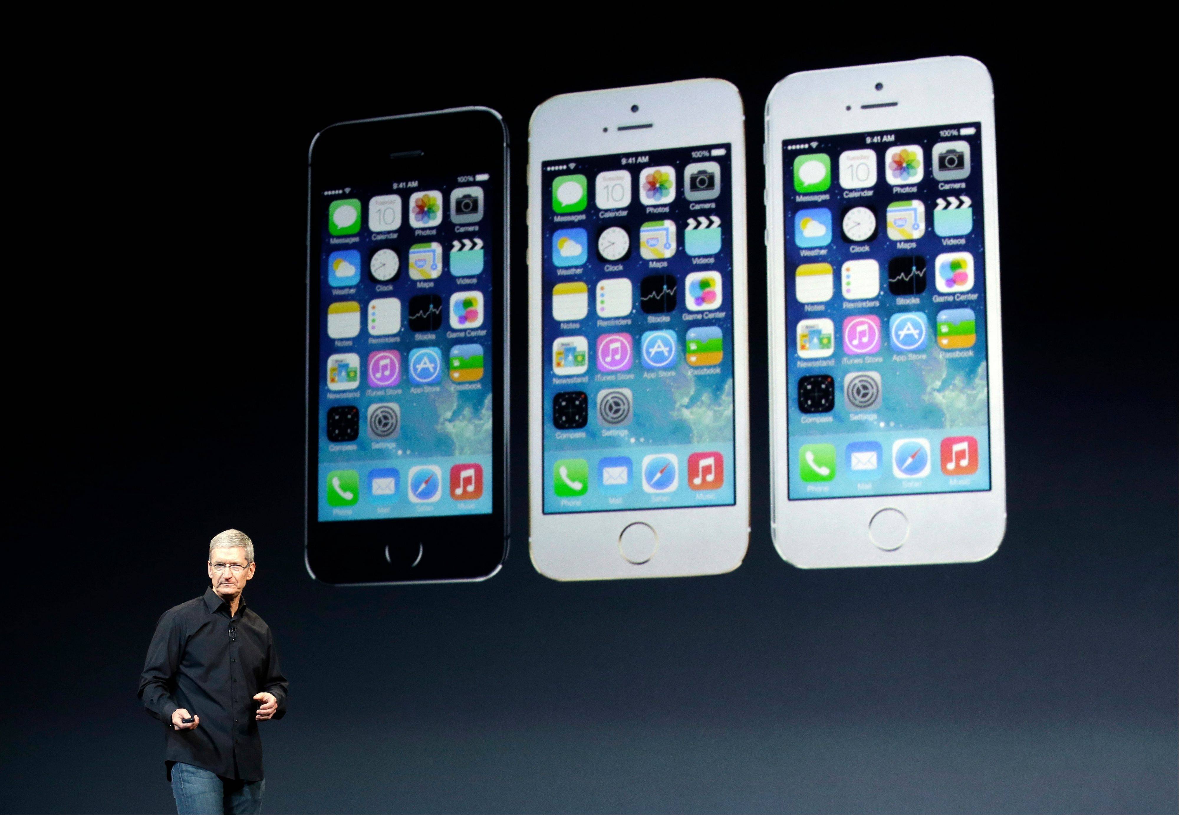 Apple CEO Tim Cook speaks on stage before a new product introduction Oct. 22 in San Francisco. Apple on Monday forecast gross margins that missed analysts' projections.