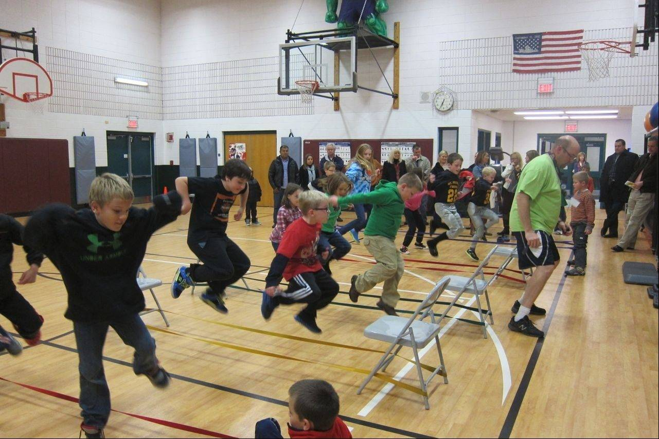 Westgate third-graders learned the art of Chinese jump rope from P.E. teacher Eric Kirschner during the Westgate World's Fair Oct. 23.