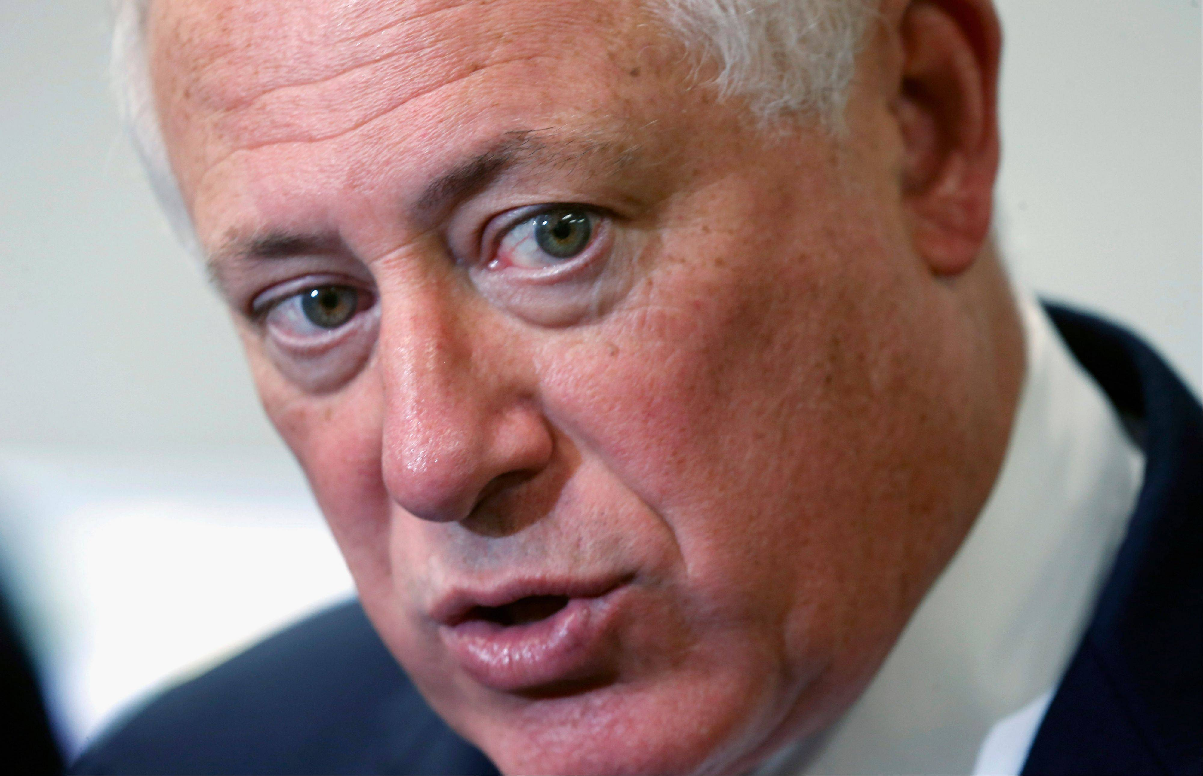 In this Oct. 24file photo, Gov. Pat Quinn responds to a question about the ongoing legislative issues in Springfield, after a visit to a Wheeling high school. The Quinn administration wants lawmakers to approve $221 million in extra funds to spend this fiscal year, a request that follows the $35 billion budget approved by the legislature in May.