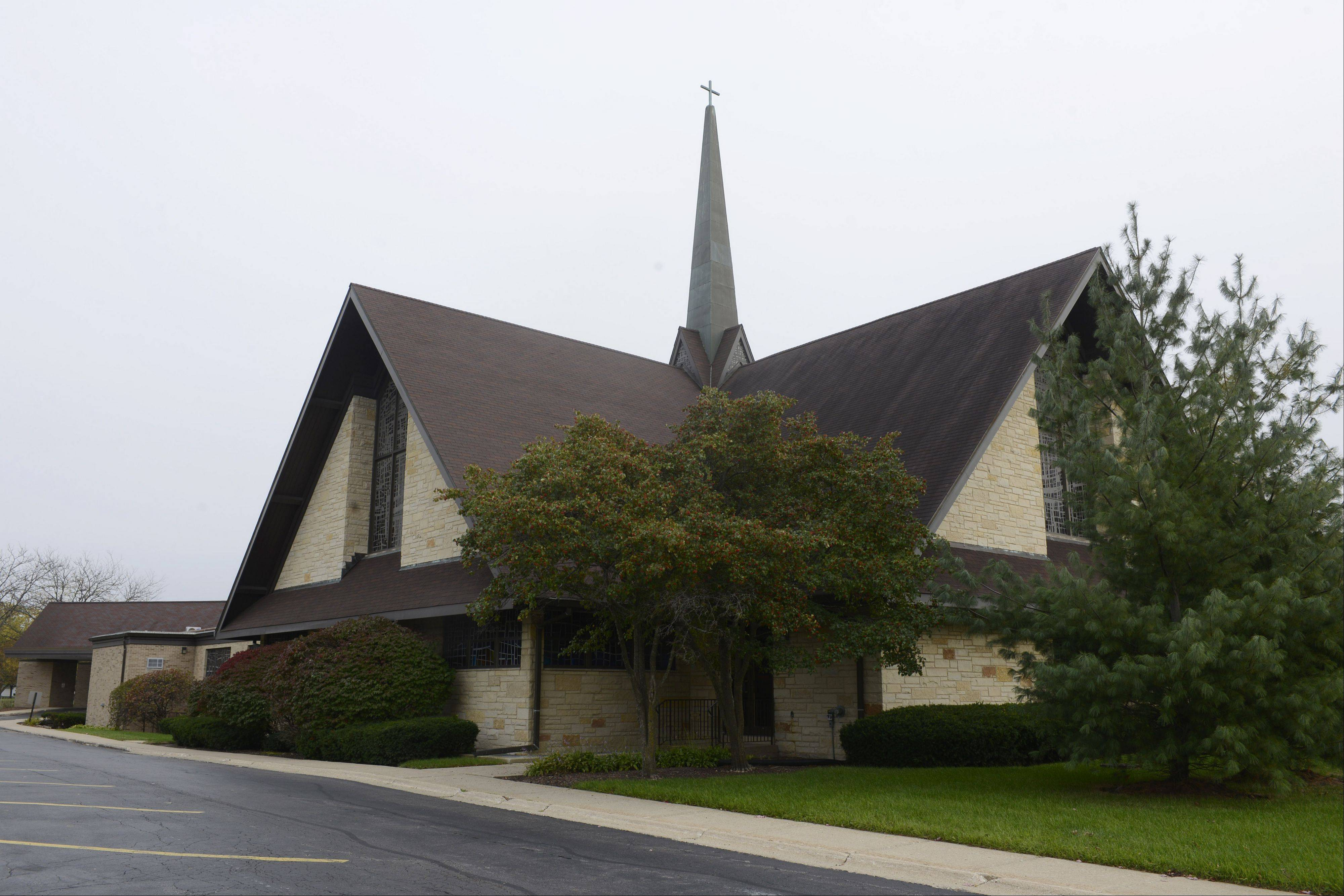 JOE LEWNARD/jlewnard@dailyherald.com Orchard Evangelical Free Church is dropping its controversial plan to tear down eight homes in its Arlington Heights neighborhood to make room for additional parking. Church leaders made the decision after a meeting Sunday night.