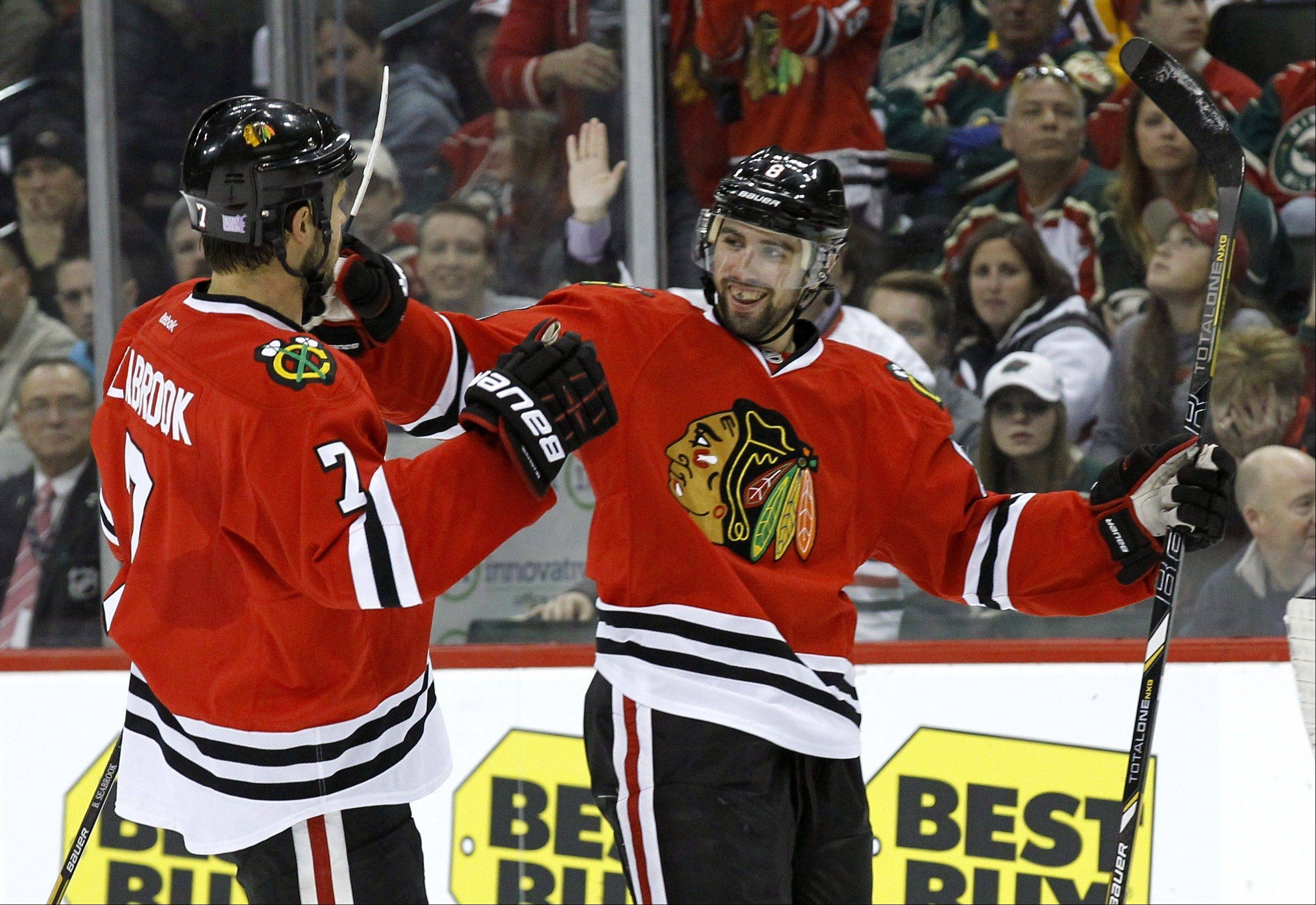 Chicago Blackhawks defenseman Nick Leddy, right, and Chicago Blackhawks defenseman Brent Seabrook, left, celebrate after Leddy�s goal on Minnesota Wild goalie Niklas Backstrom during the second period of an NHL hockey game Monday night in St. Paul , Minn. The Blackhawks beat the Wild 5-1.
