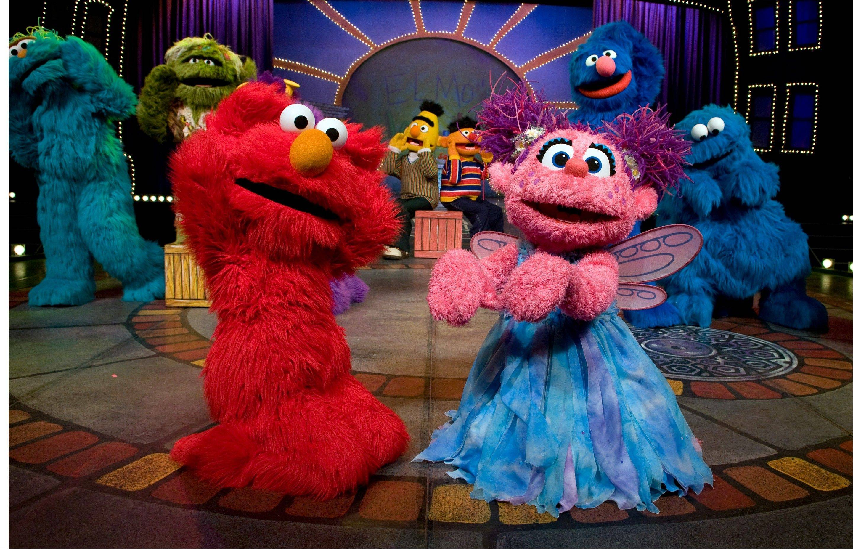 "Elmo and Abby Cadabby, pictured here in the ""Sesame Street"" show ""1-2-3 Imagine! with Elmo & Friends,"" will perform at the Sears Centre Arena in Hoffman Estates in April 2014 in the show ""Can't Stop Singing."""