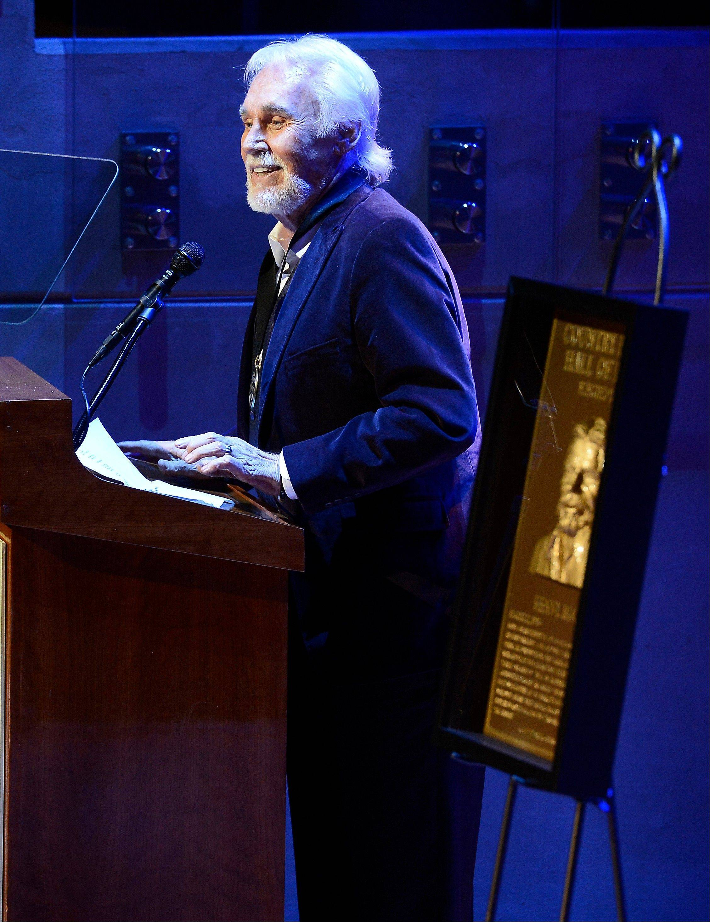 Country music star Kenny Rogers gives his acceptance speech at the ceremony for the 2013 inductions into the Country Music Hall of Fame on Sunday in Nashville, Tenn.