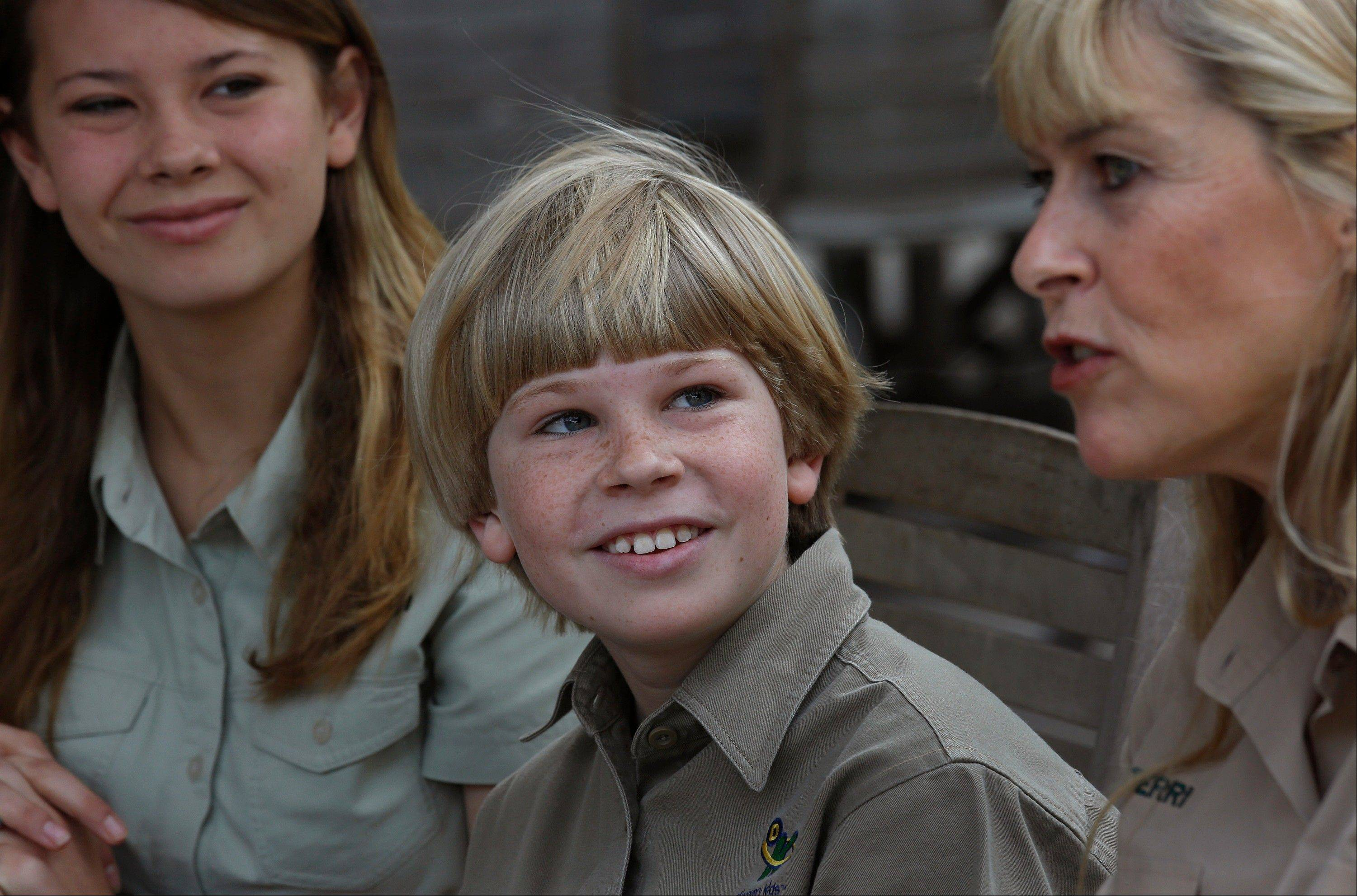 "Robert Irwin, 9, the son of the late Stephen Irwin, Australia's ""Crocodile Hunter,"" is following his father's footsteps by making his debut as a television host. He co-hosts ""Wild But True,"" a show on Discovery Kids that explores parallels between nature and science. He's sitting in between mom Terri and sister Bindi Irwin."