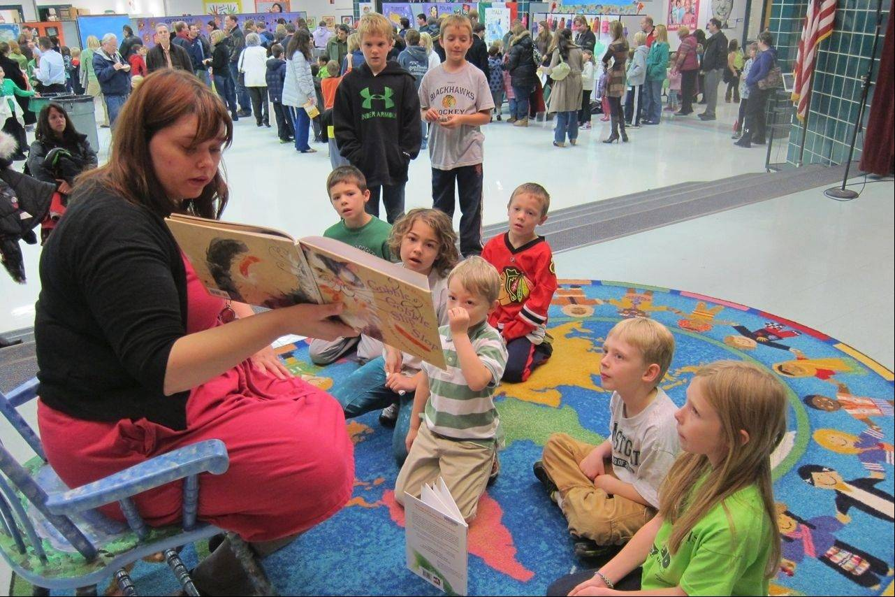 Julie Jurgens, of the Arlington Heights Memorial Library, led third-grade Westgate students in storytelling of different cultures during the Westgate World's Fair Oct. 23.