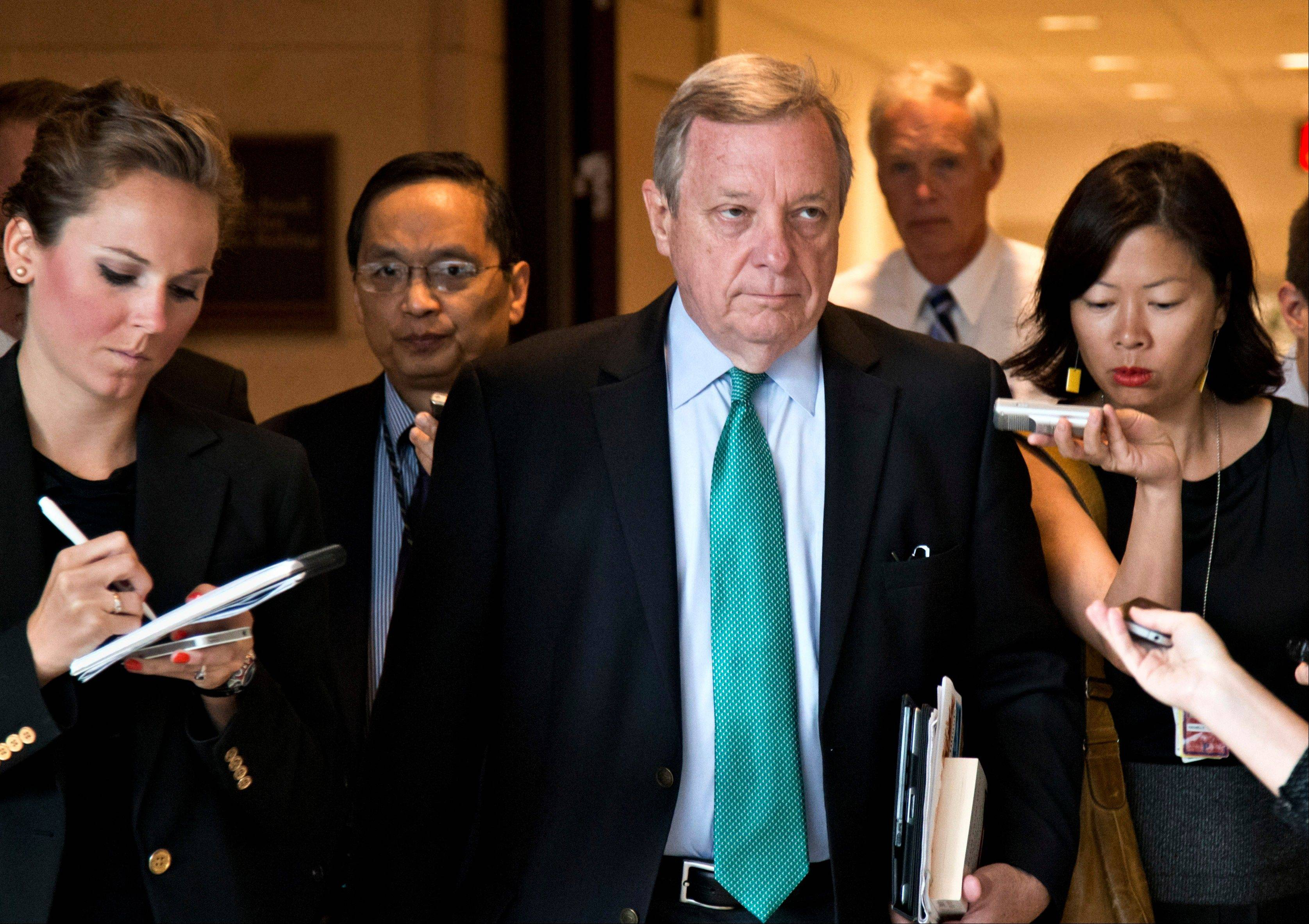 This Sept. 4, 2013, file photo shows Illinois Democrat Sen. Dick Durbin, the Senate assistant majority leader, arriving for a top-secret briefing for senators with Secretary of State John Kerry at the Capitol in Washington. On Mondayin Chicago, Durbin says he had no problem taking down a Facebook post disputed by the Obama administration once White House officials acknowledged giving him wrong information.