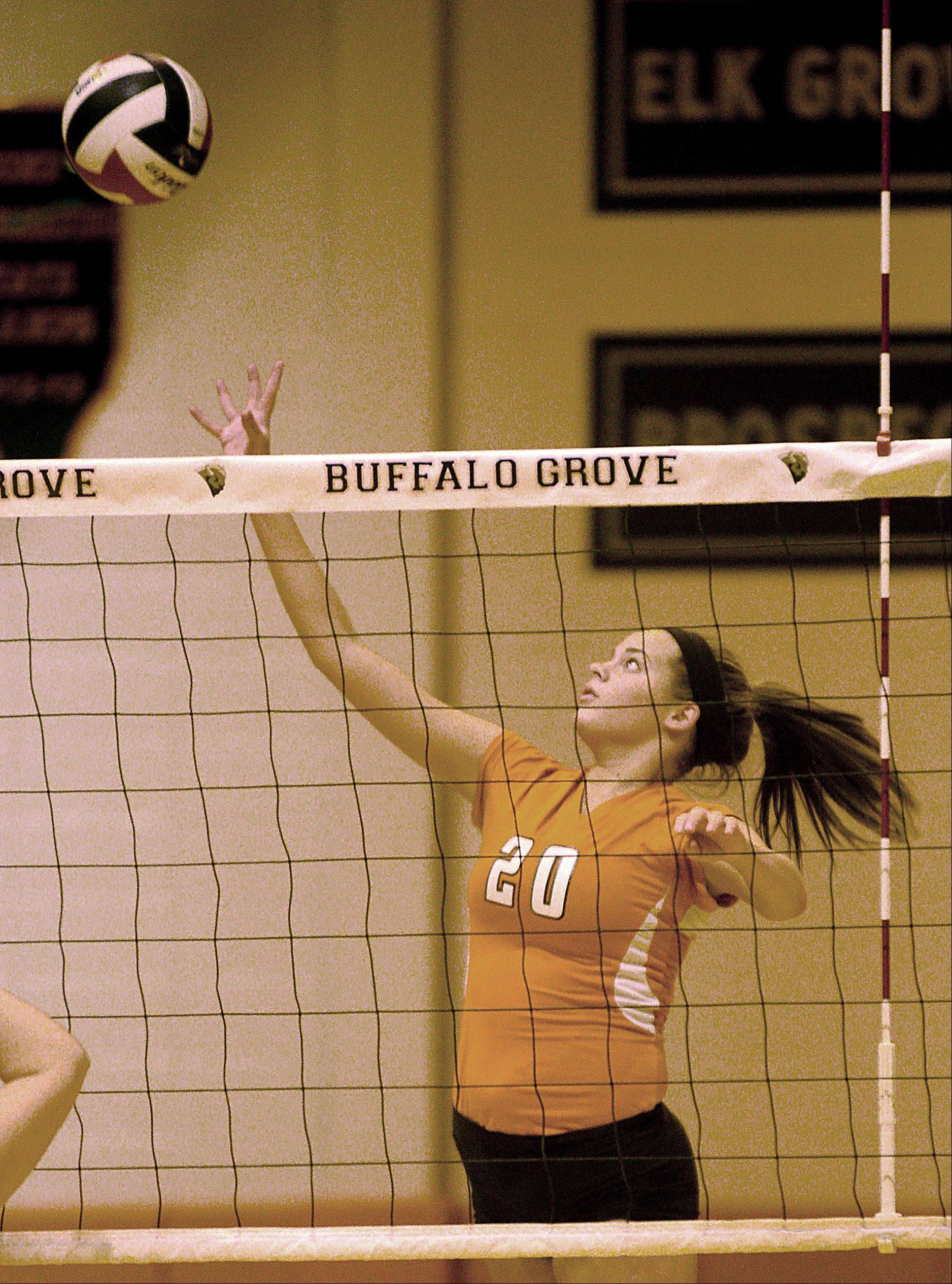 Buffalo Grove's Alaina Murphy tips the ball during a varsity volleyball game against Deerfield at Buffalo Grove on Monday night.