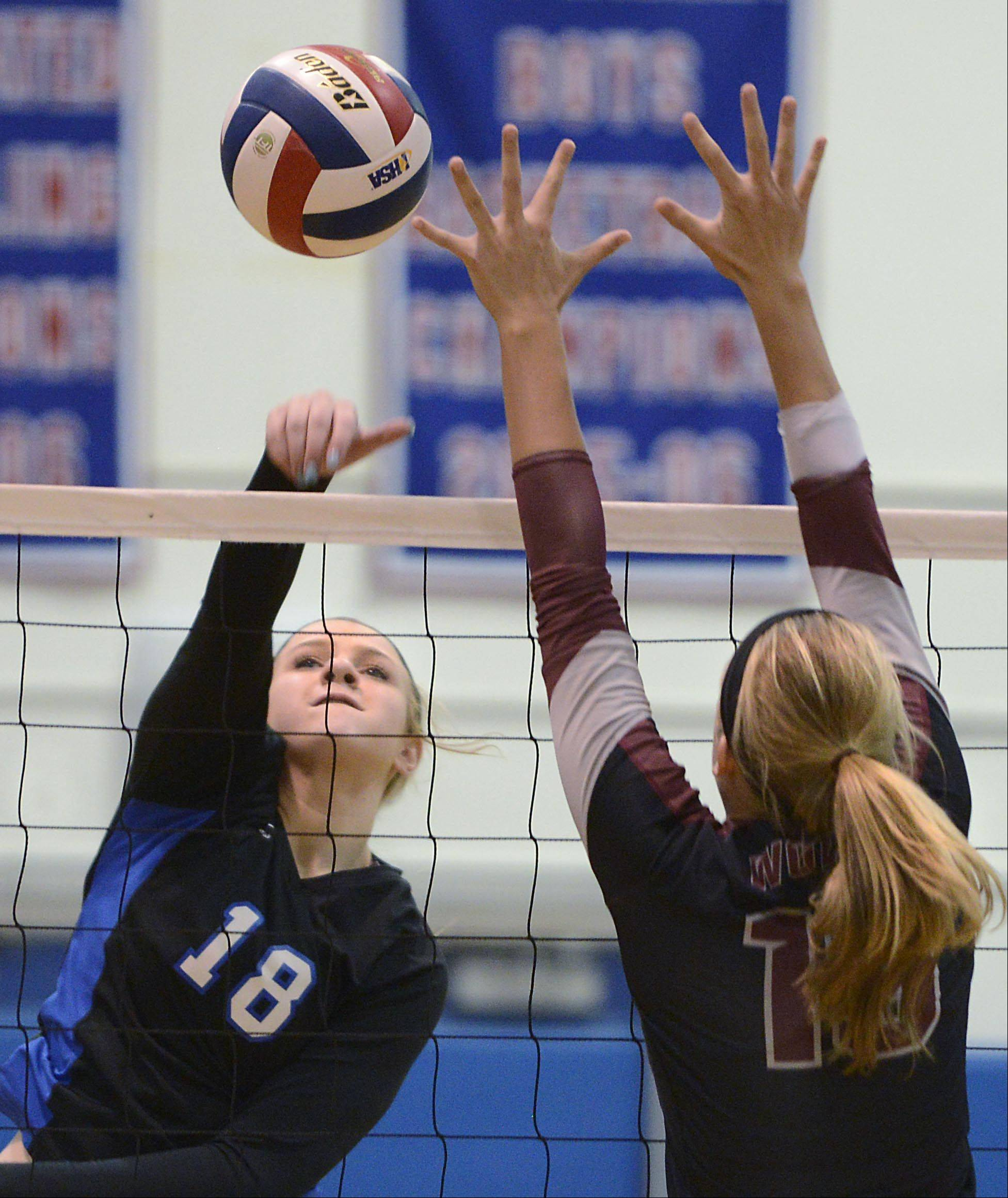 Dundee-Crown's Kailey Moll sends a shot past Prairie Ridge's Ali Witt Monday in Carpentersville.
